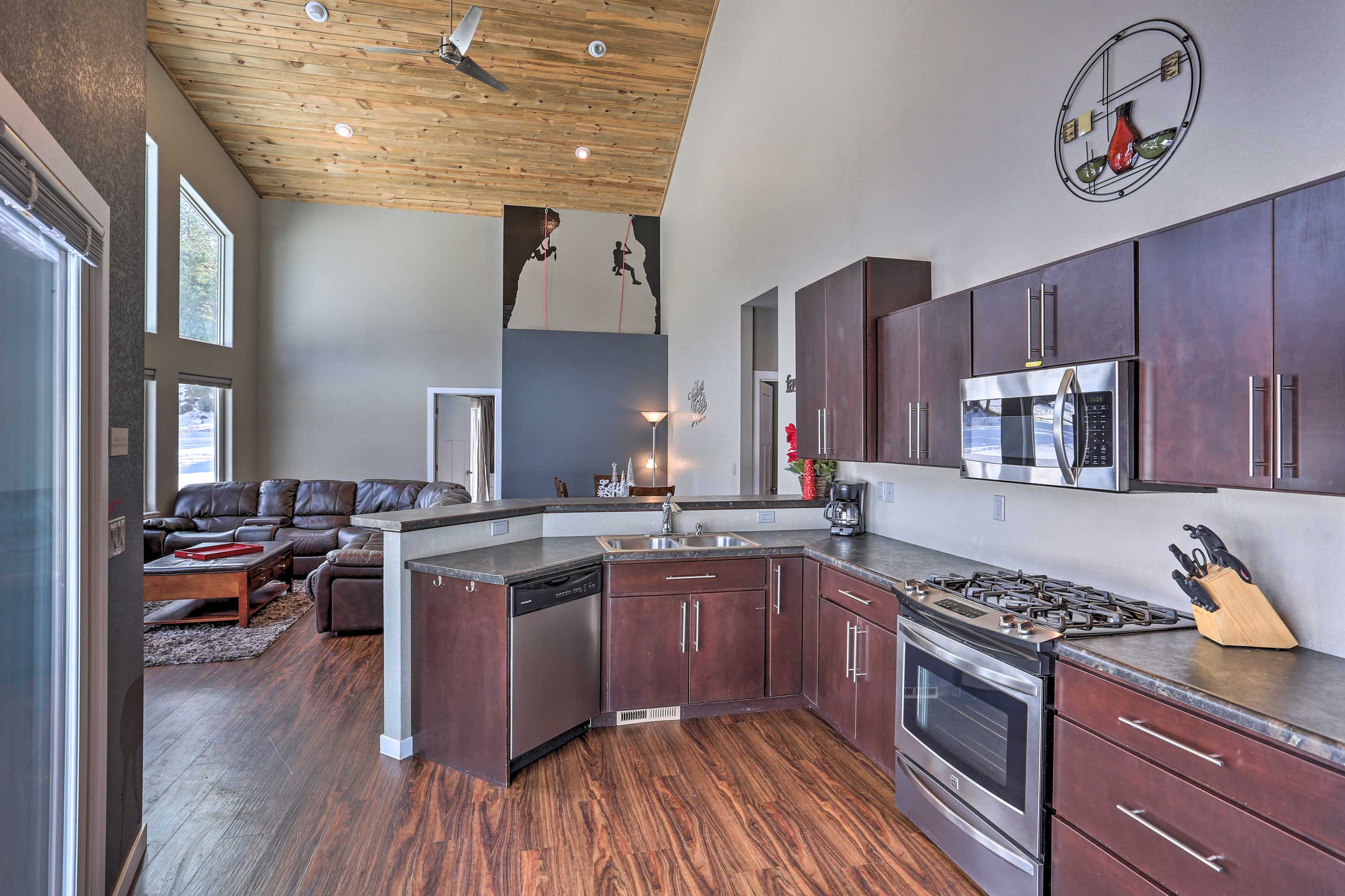 The open layout, high ceilings and plentiful natural light highlight the home.