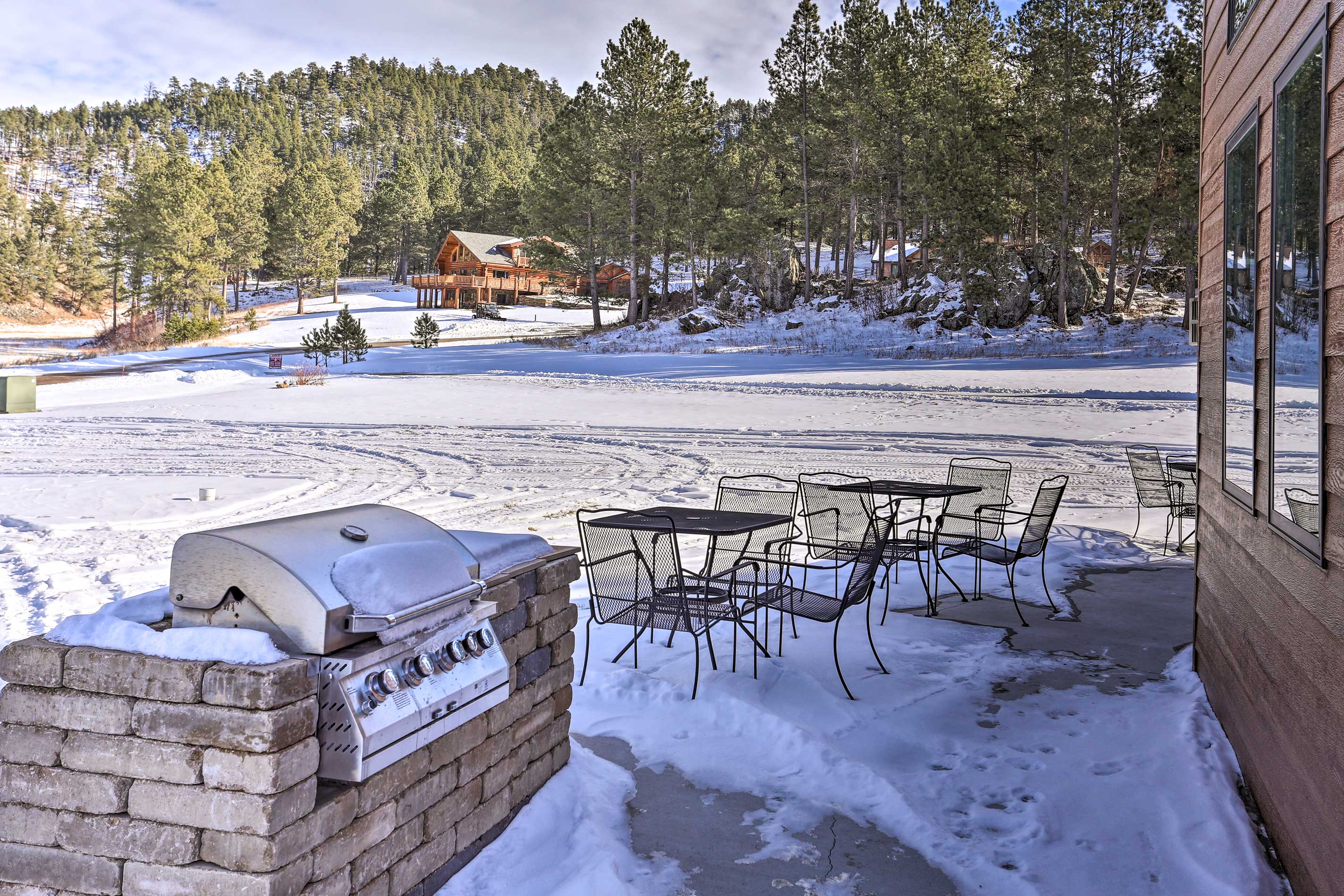 This vacation rental features an outdoor patio, gas grill, and hot tub.