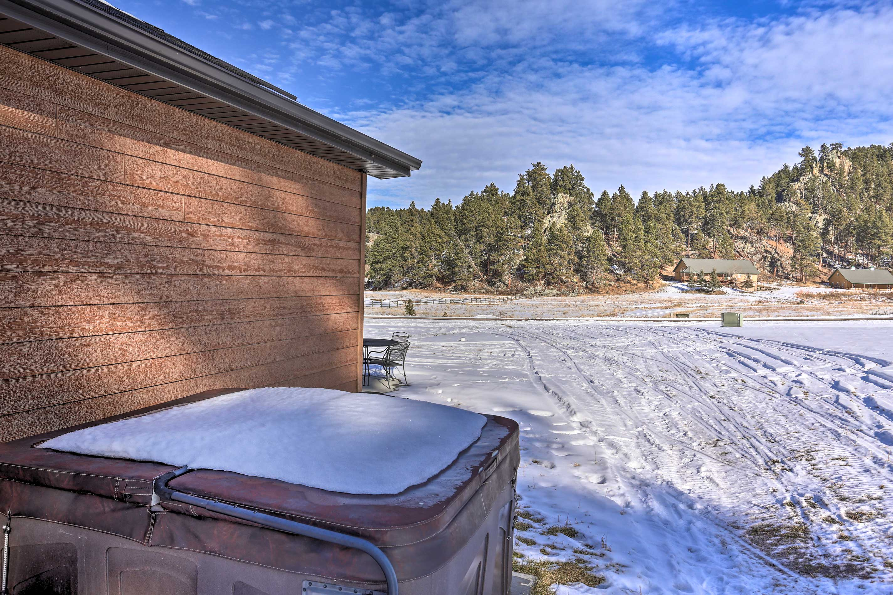 After a day of hiking, soak your sore muscles in the private hot tub.