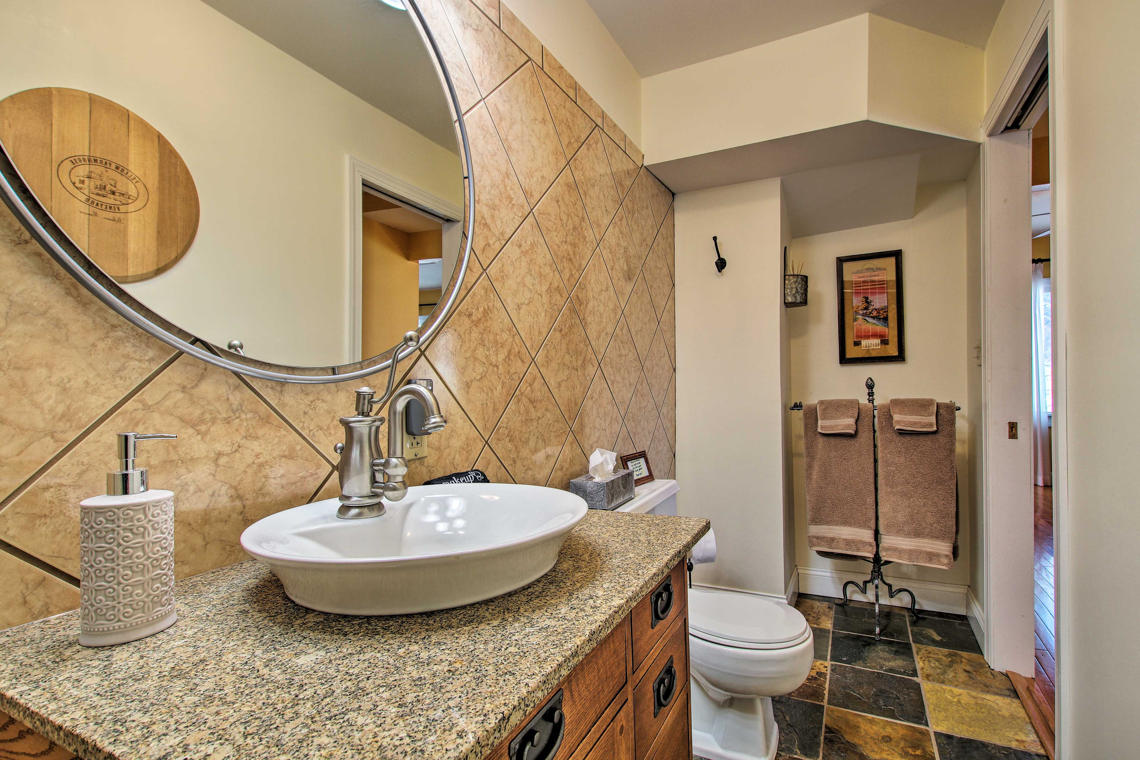 The 2 full bathrooms are stocked with complimentary toiletries & towels.