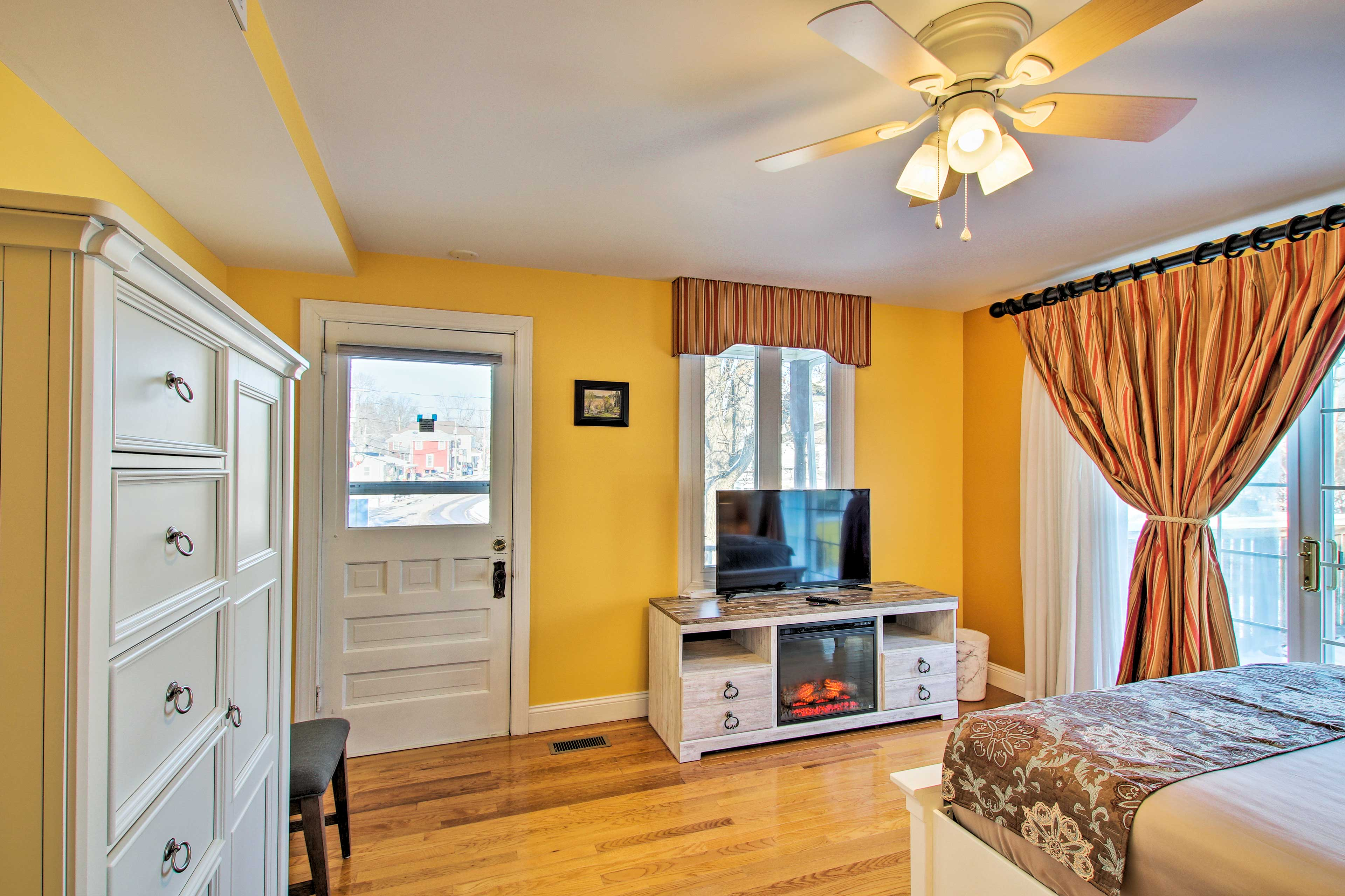 Get cozy in front of the electric fireplace & flat-screen Smart TV.
