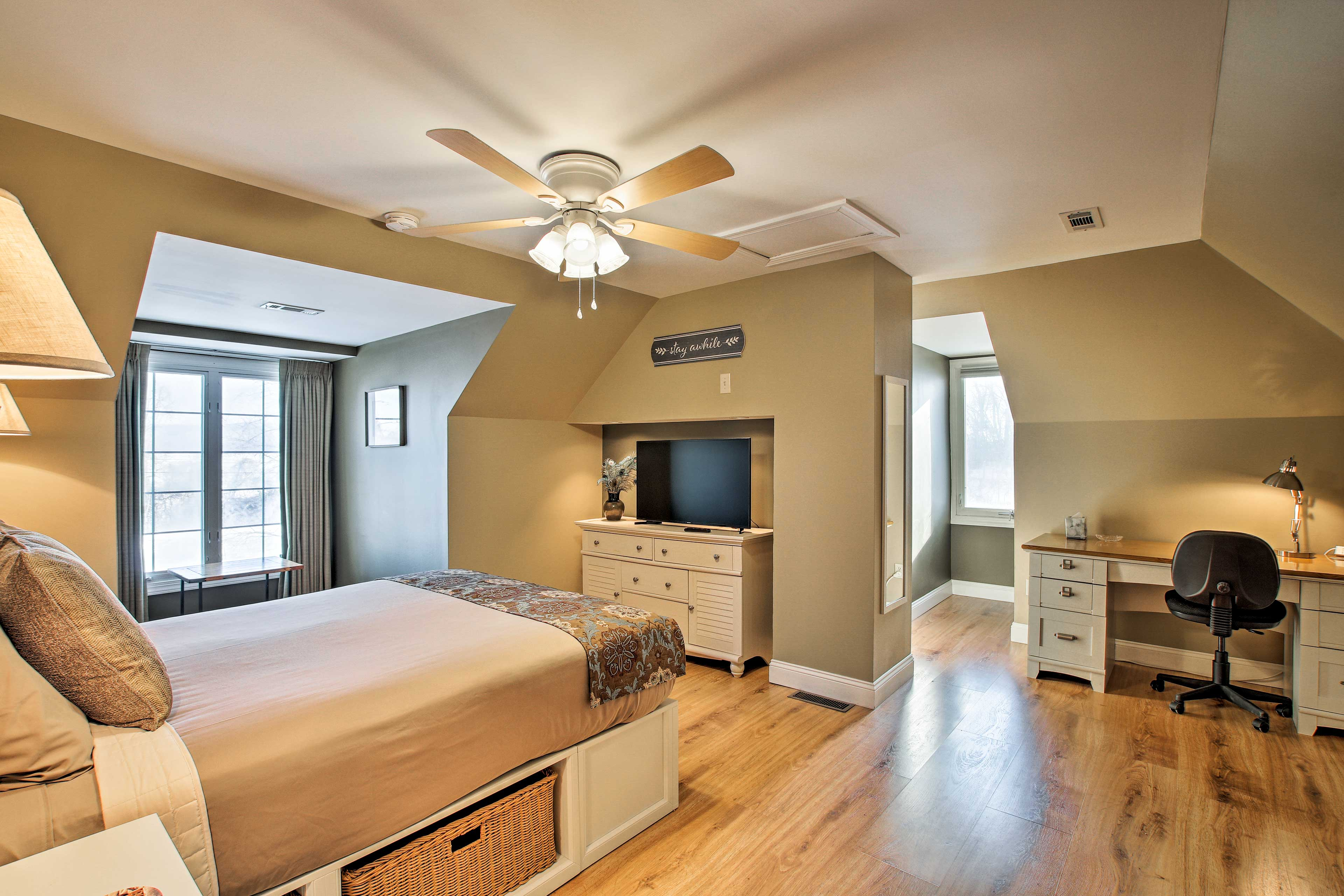 The room also features a flat-screen Smart TV, plus a laptop-friendly workspace.