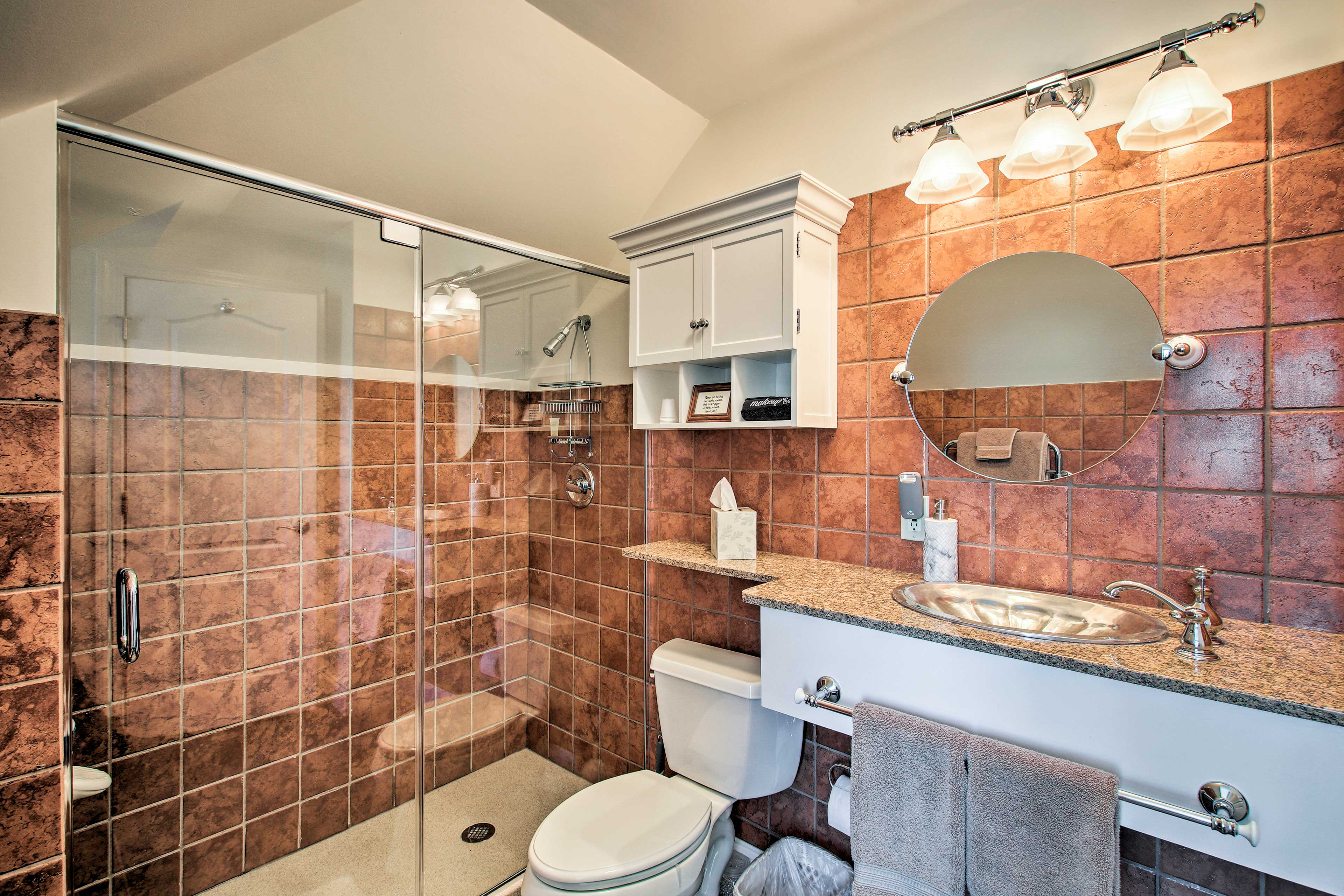 Rinse off in this luxury walk-in shower before bedtime.