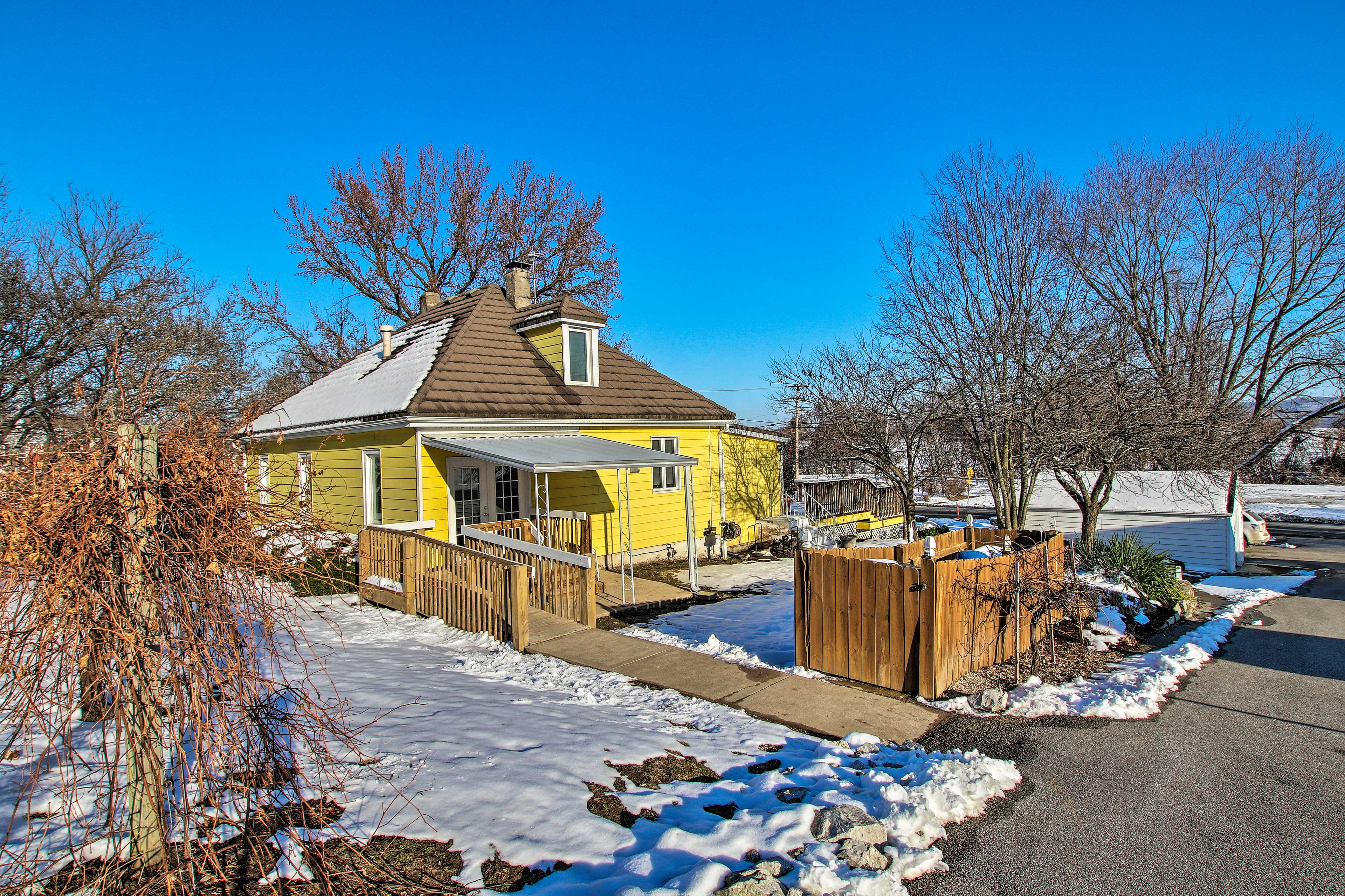 This yellow cottage is a 100+ year-old farmhouse!