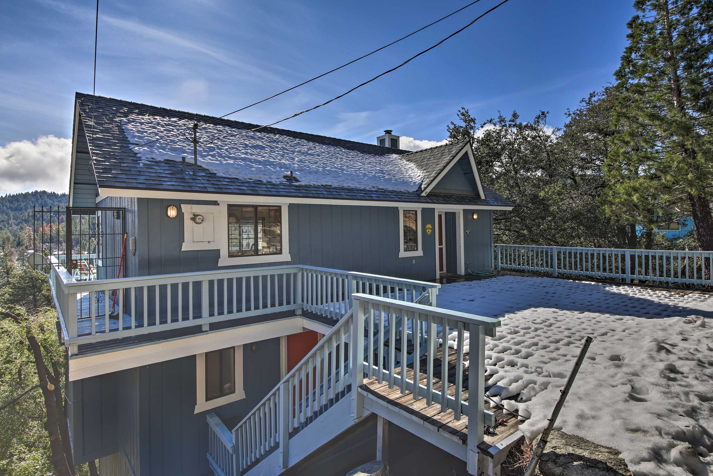 Nestled on the side of a hill, this Crestline cabin has it all!