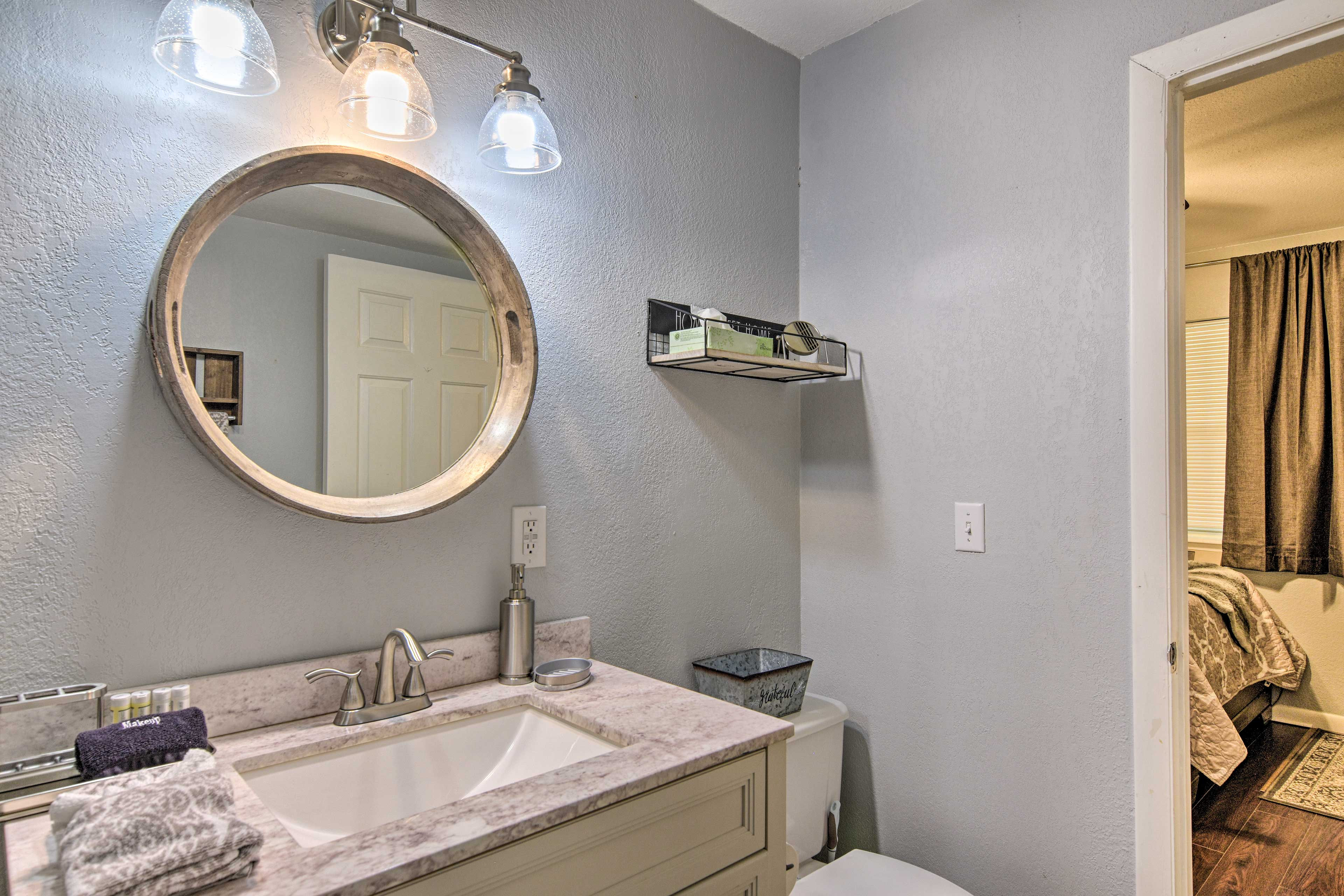 Step into the new walk-in shower with complimentary towels.