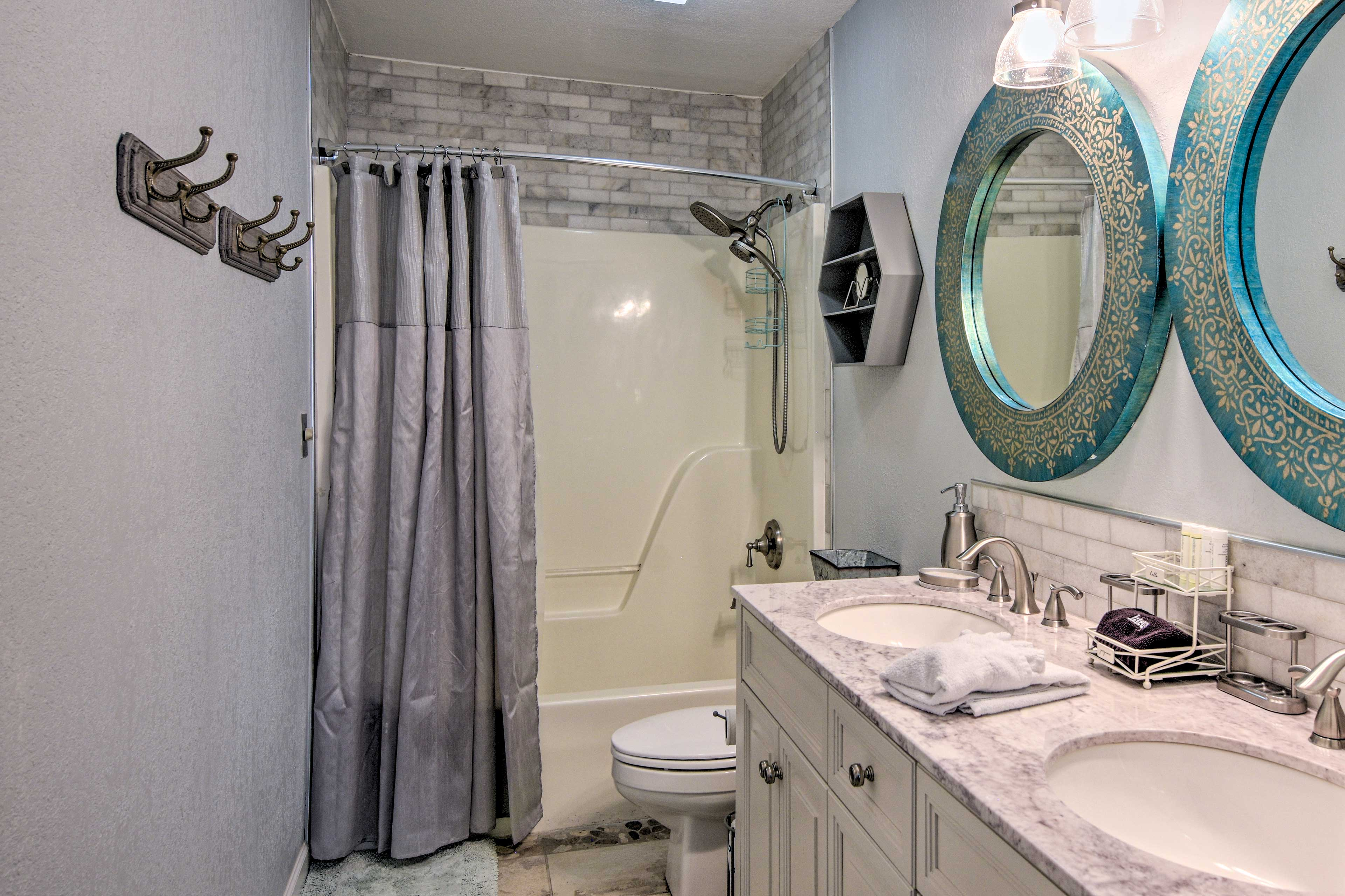 The renovated bathroom offers dual sinks.