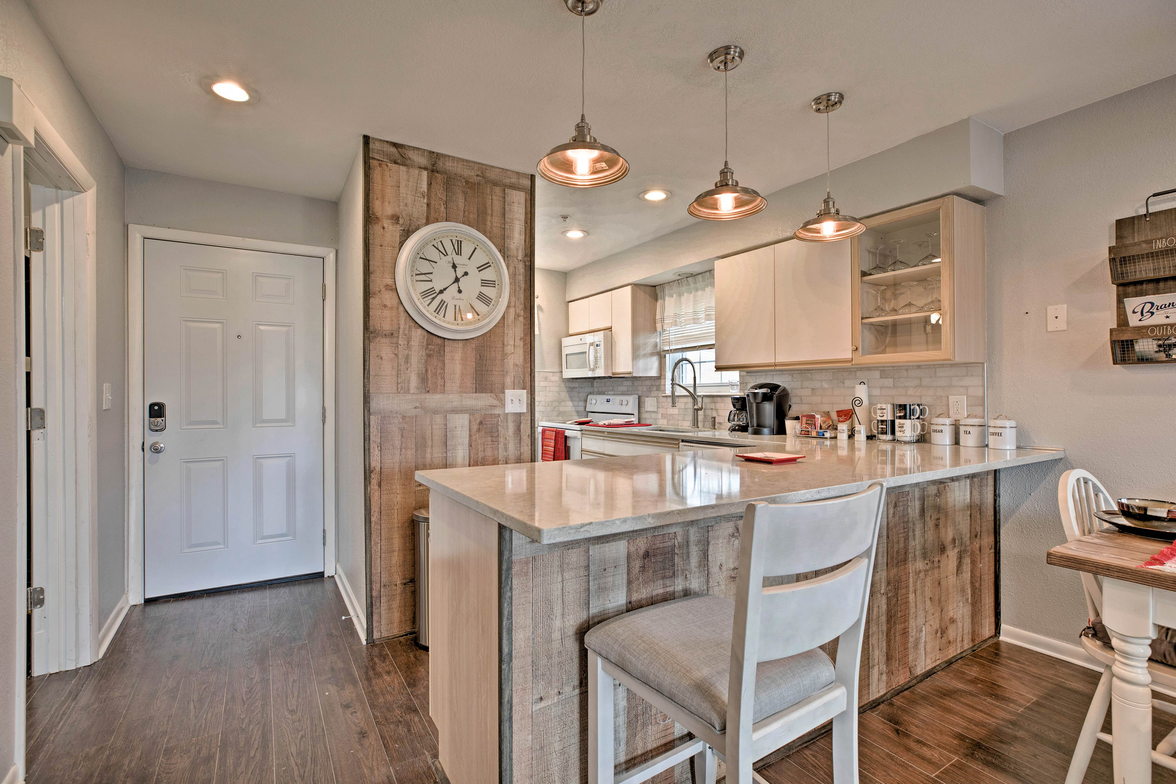 This newly remodeled kitchen features new countertops and tile.
