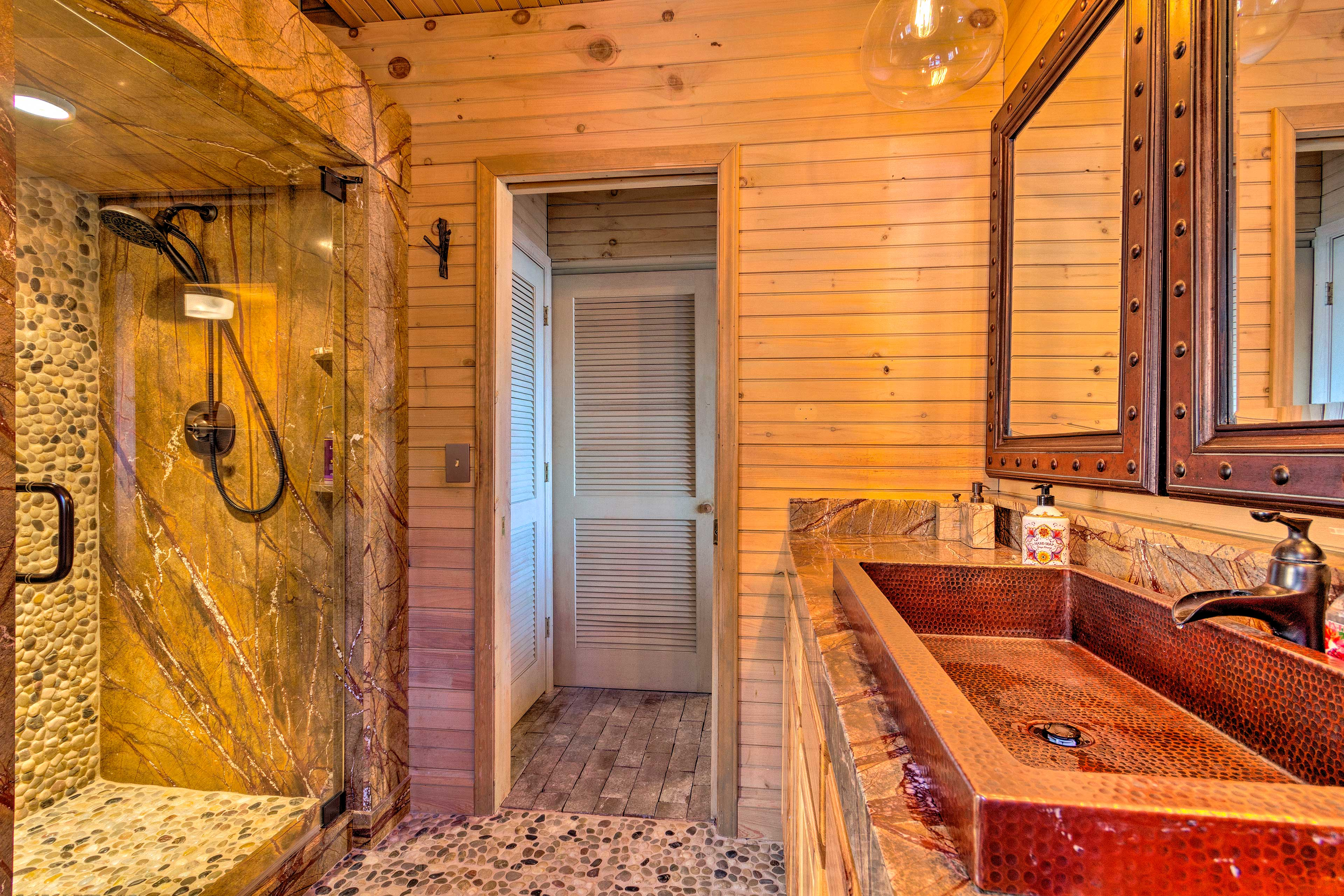 Rinse off in this luxurious river-rock walk-in shower!