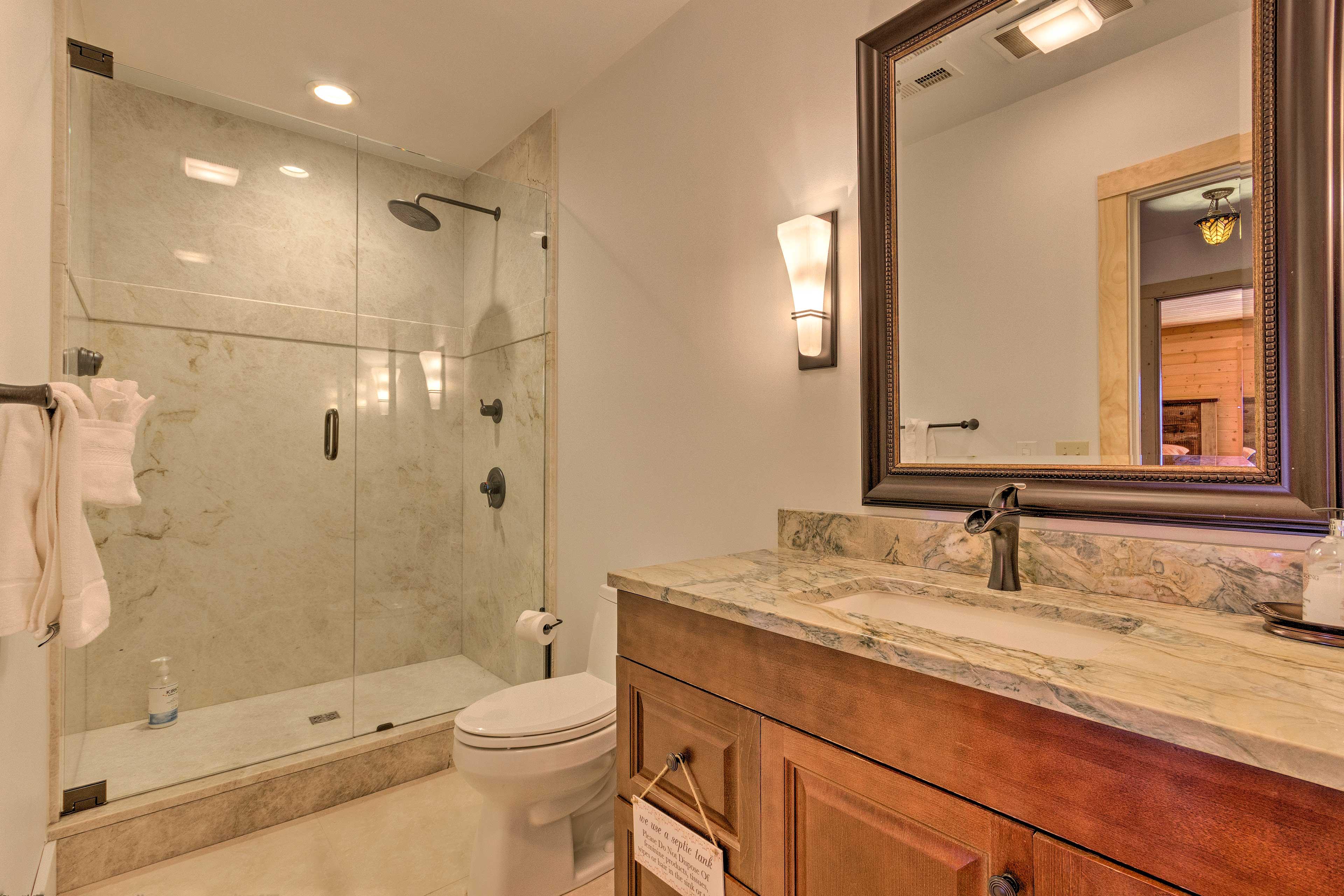 The third full bathroom features another glass-door walk-in shower.