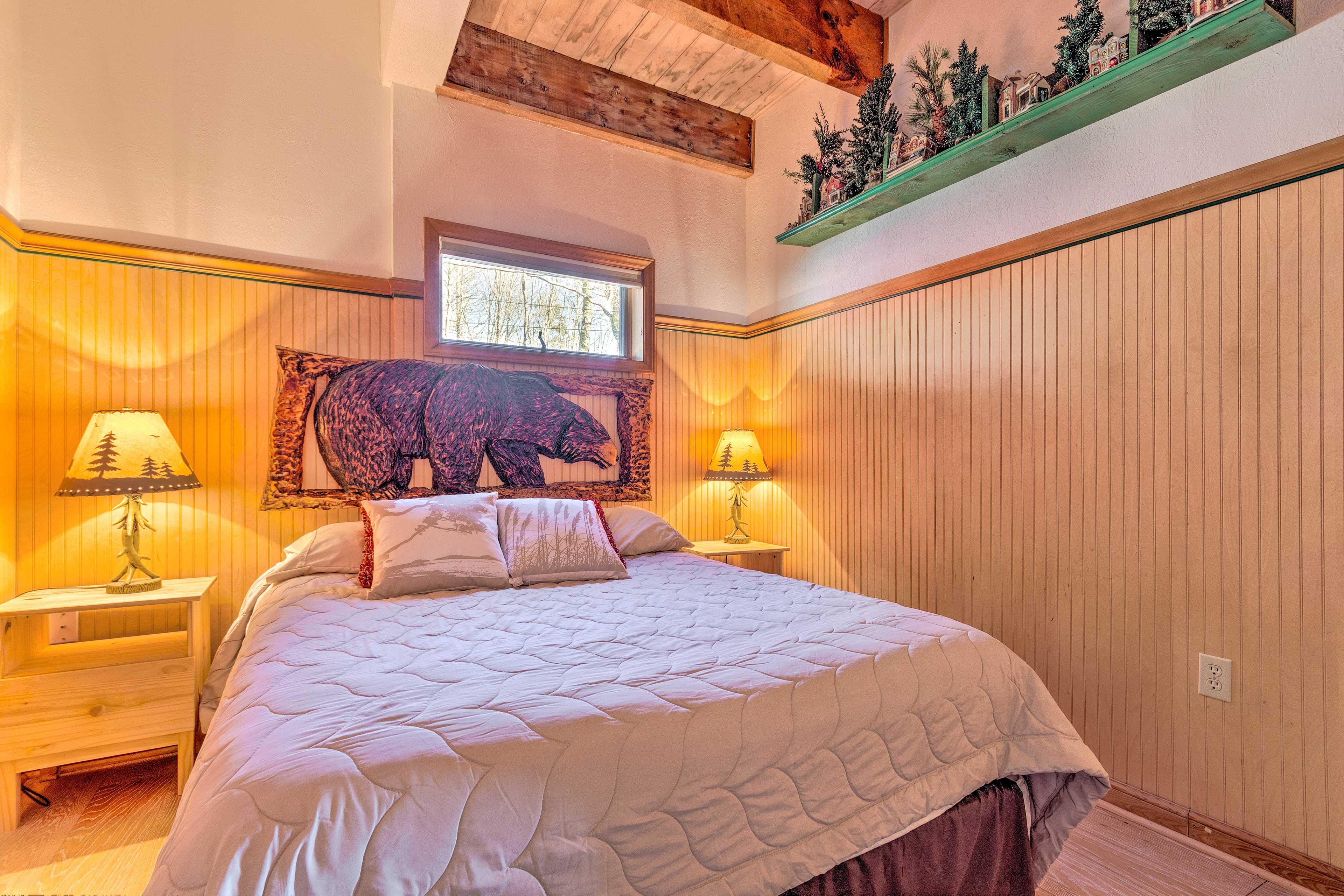 The second bedroom hosts a queen bed.
