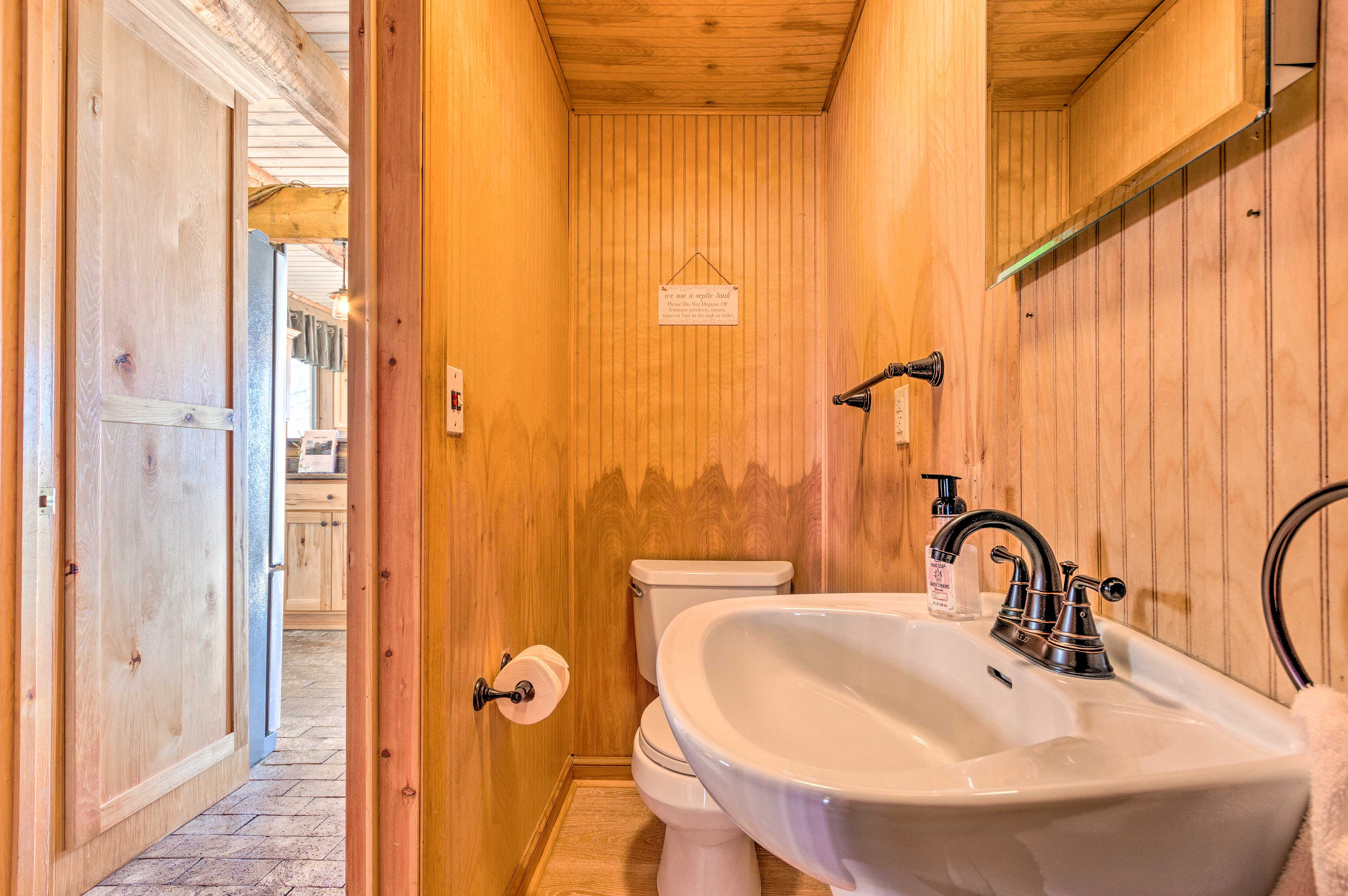 A half bath is located on the ground floor for extra convenience.