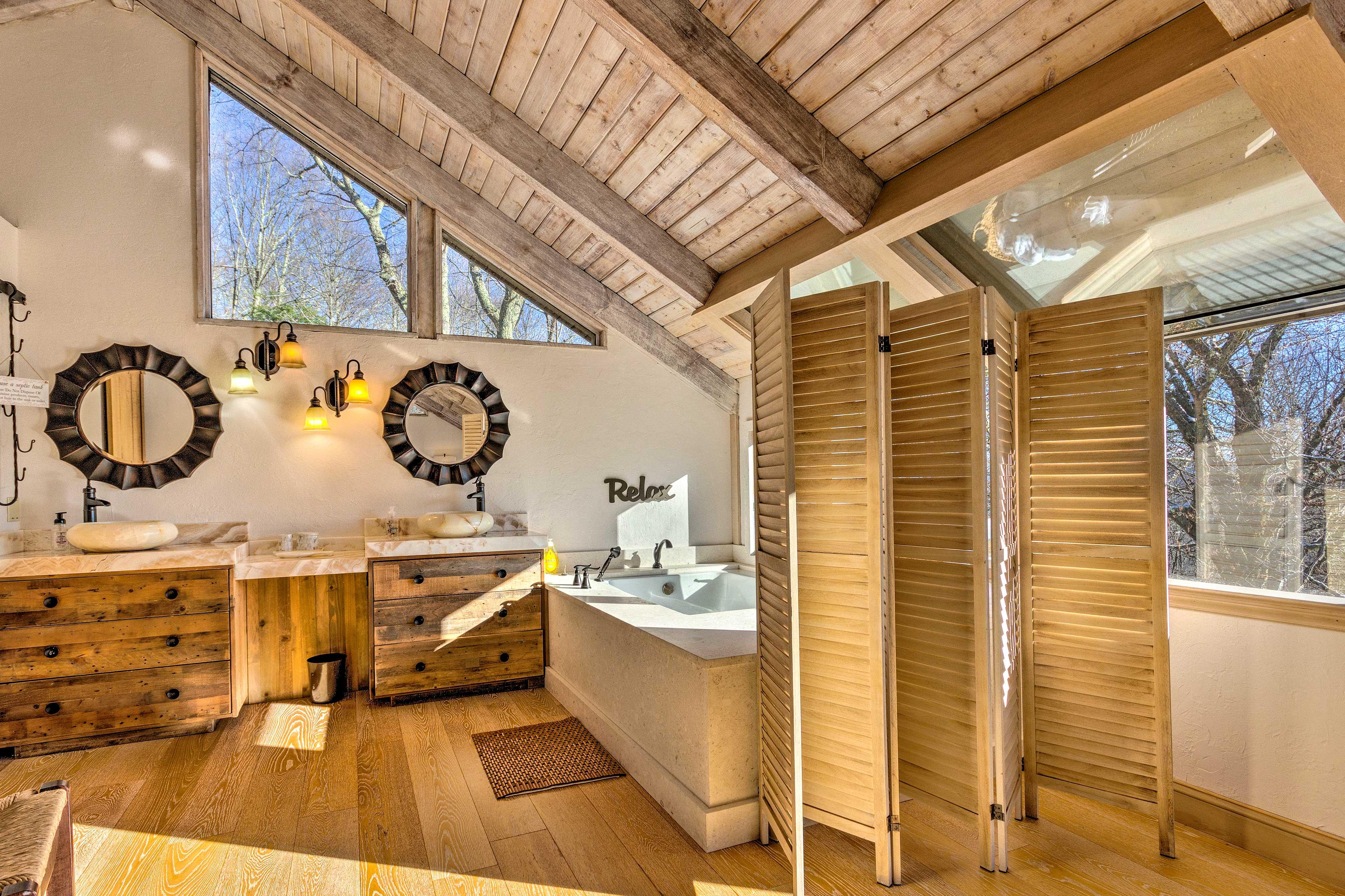 An extravagant en-suite bath is part of the master bedroom.