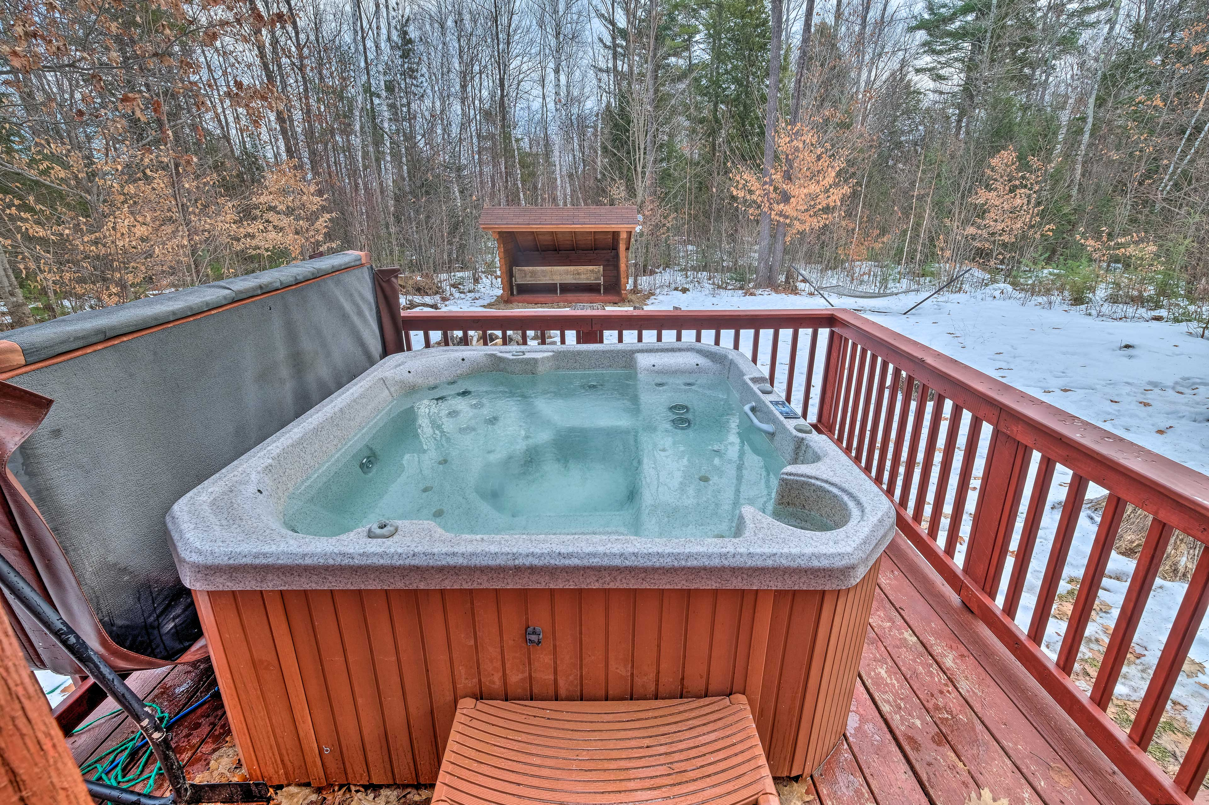 Relax in the private hot tub under the starry sky.