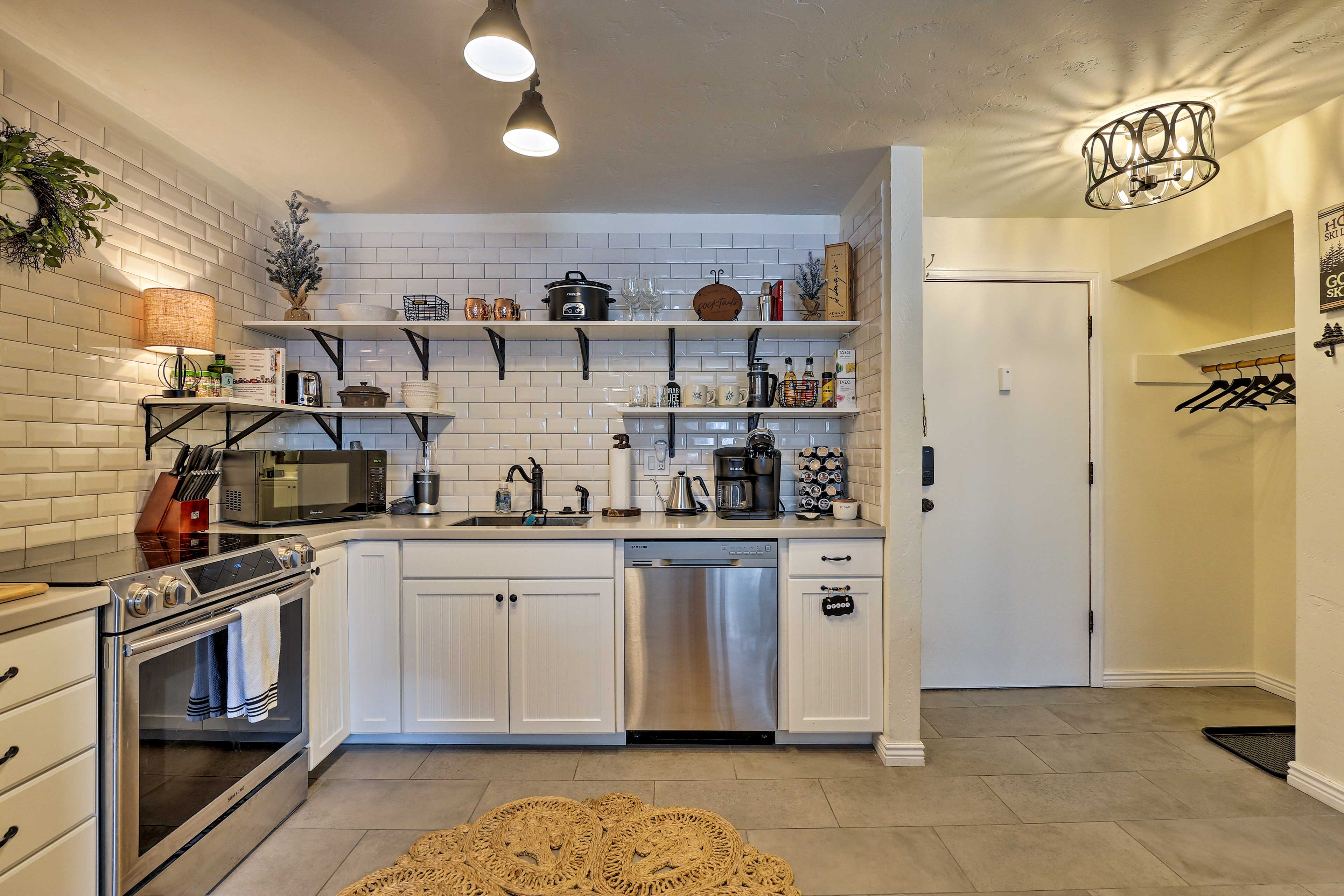 This modern, updated kitchen is fully equipped.