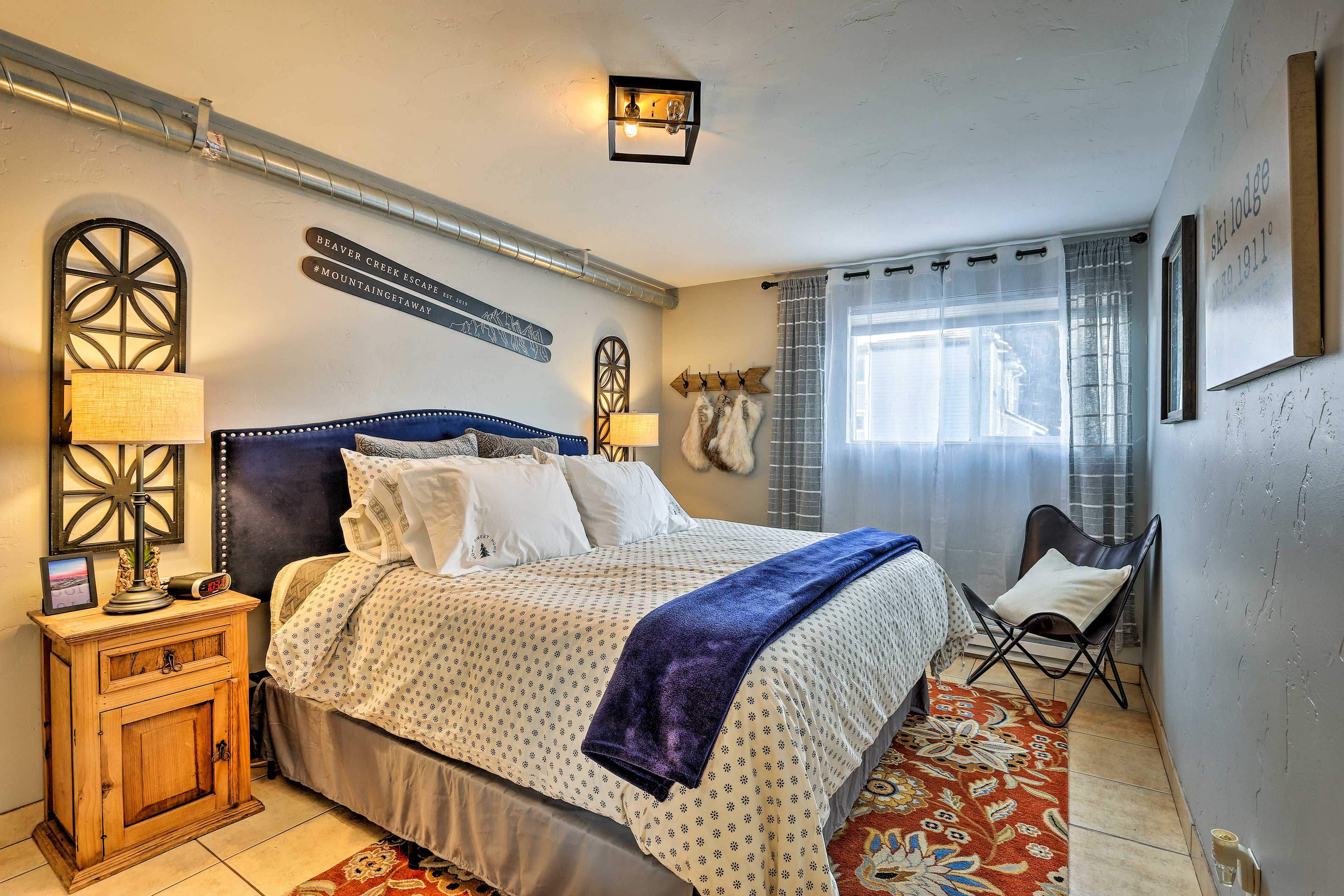 The master bedrooms boasts a king bed.