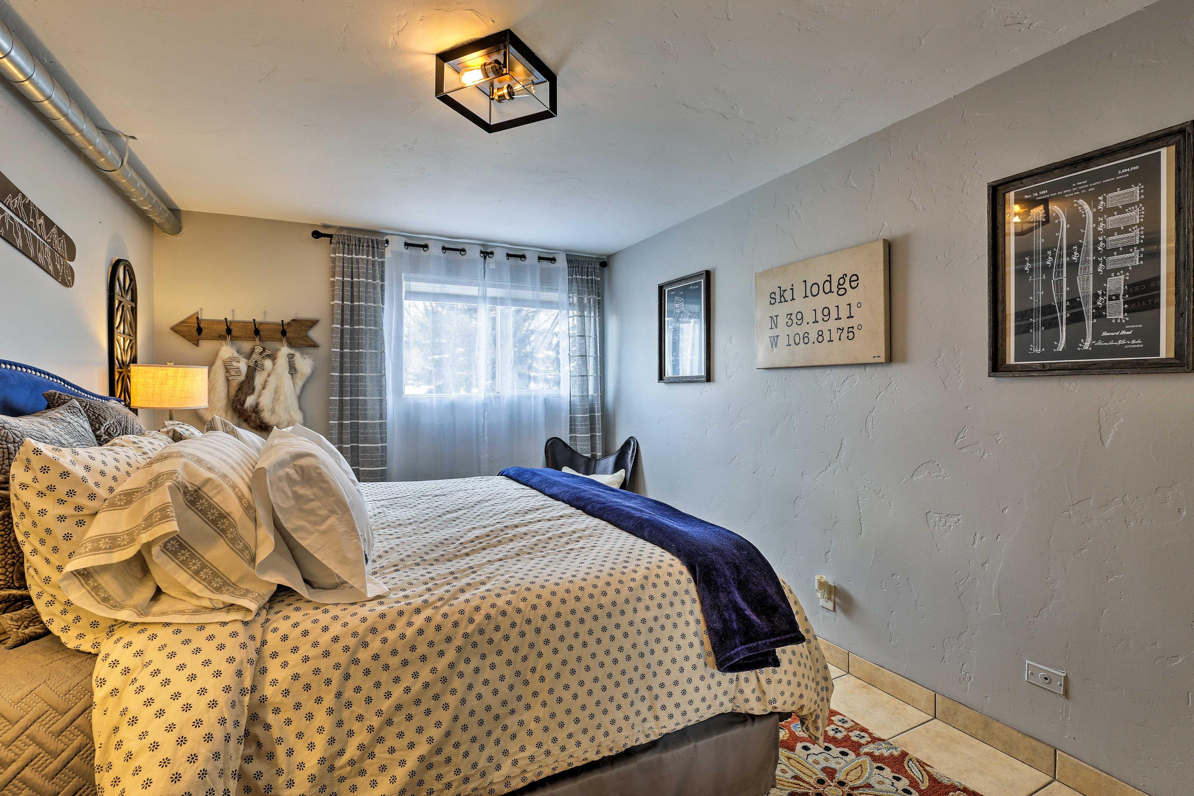 Mountain-themed decor creates a cozy, warm room.