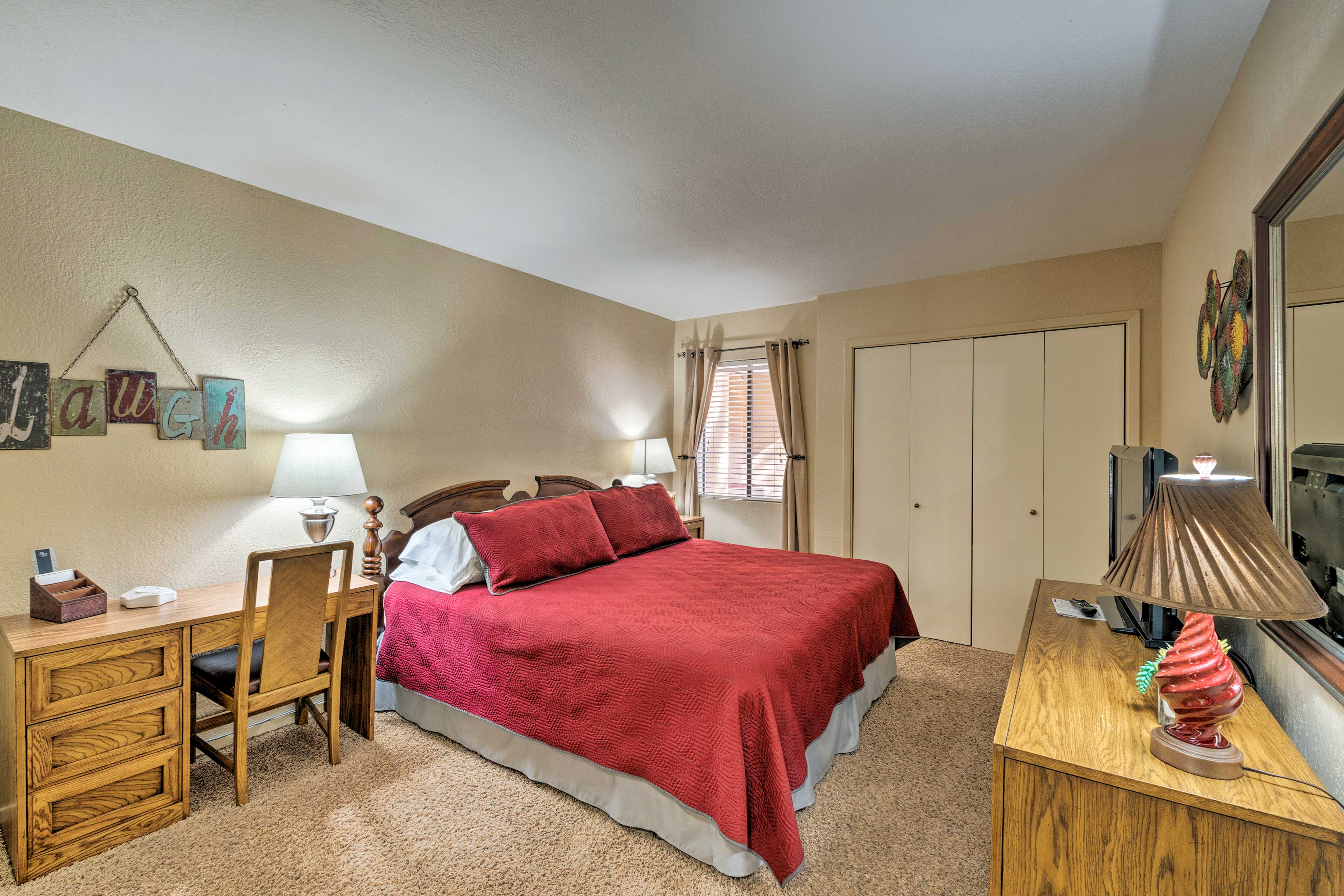 Enjoy the comfort of the king-sized bed in the master bedroom.