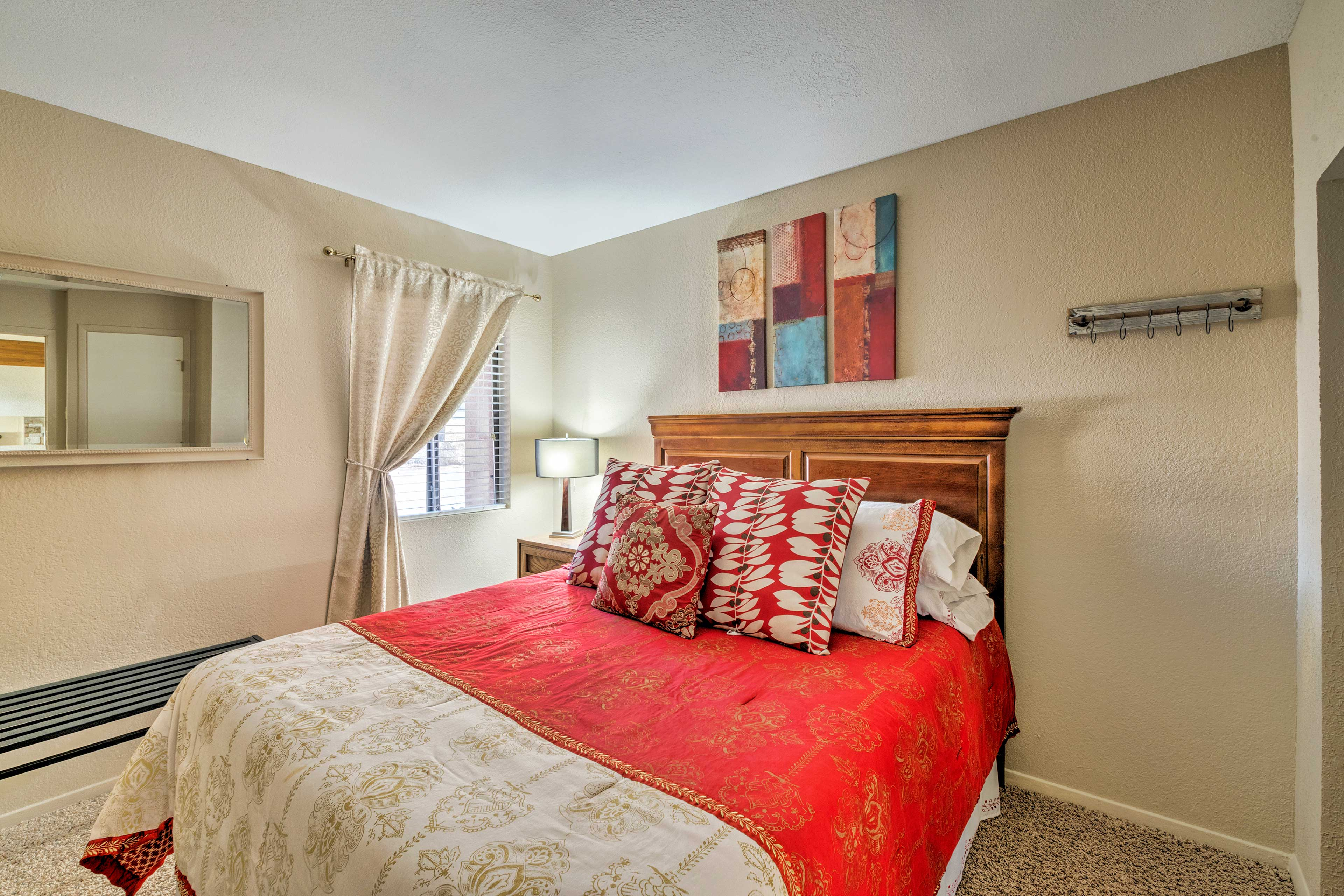 In the second bedroom you'll find a queen-sized bed.
