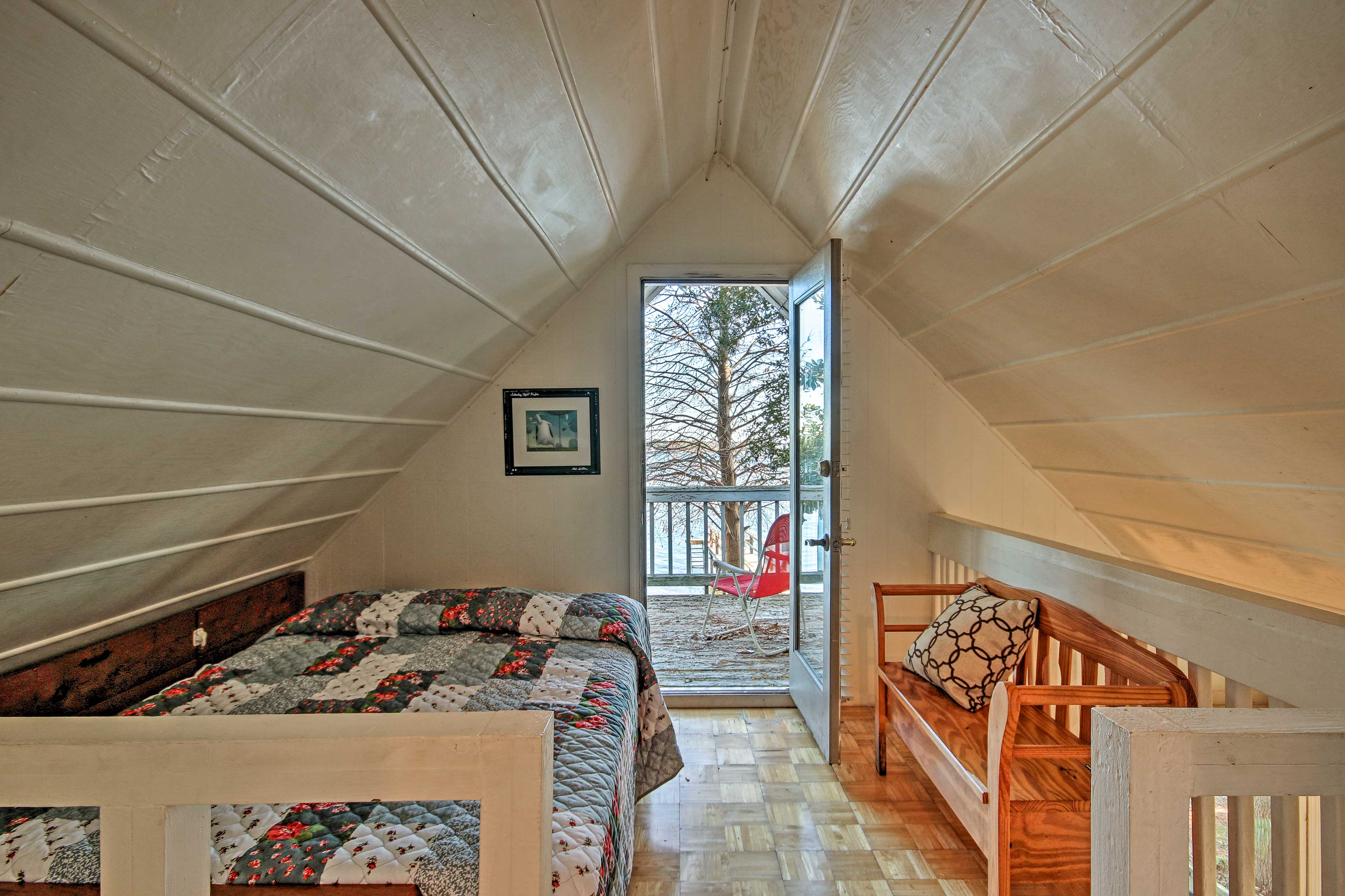 Unpack, unwind, and relax in the loft with a full bed and direct deck access.