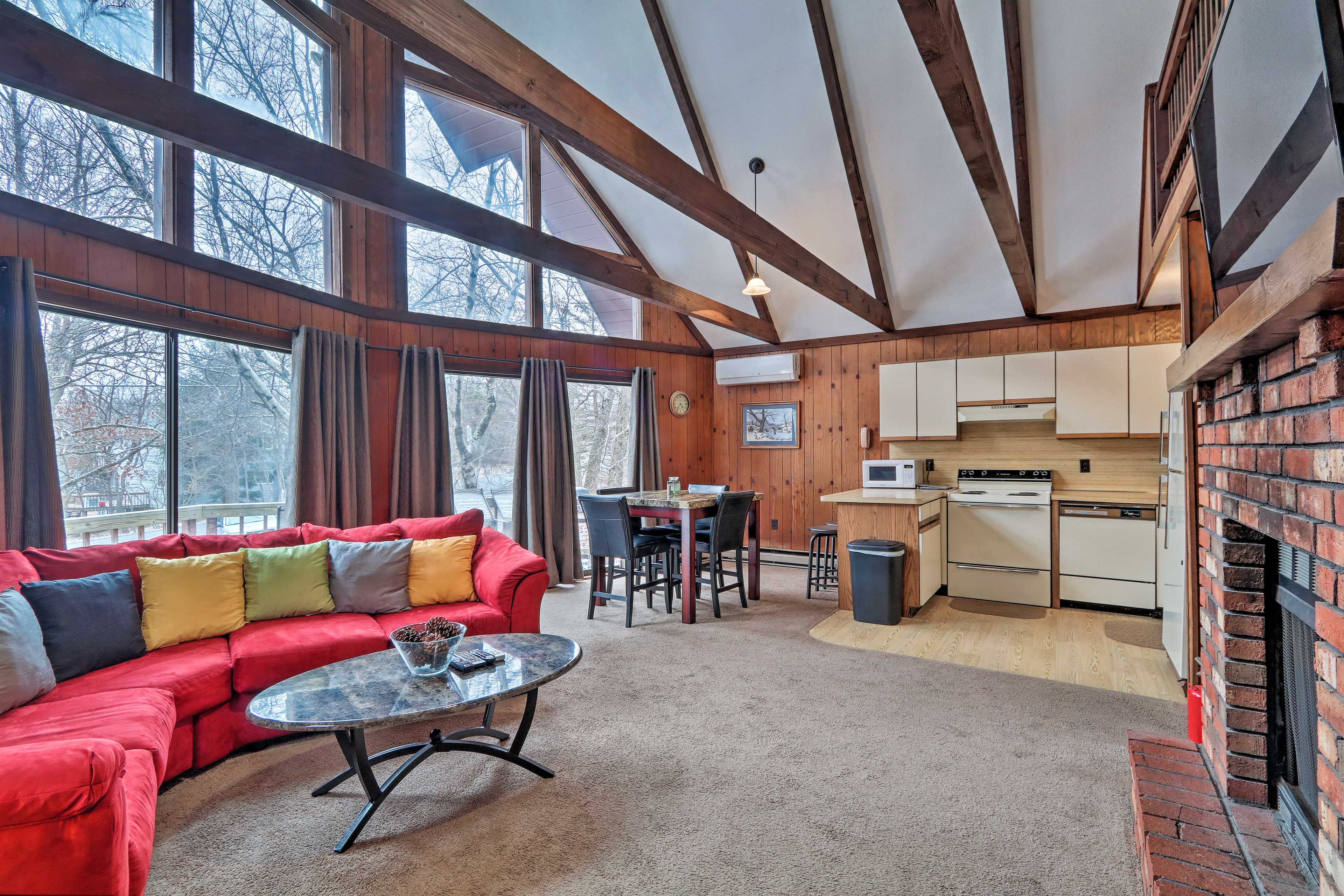 Vaulted ceilings and exposed wood beams provide a cabin feel.