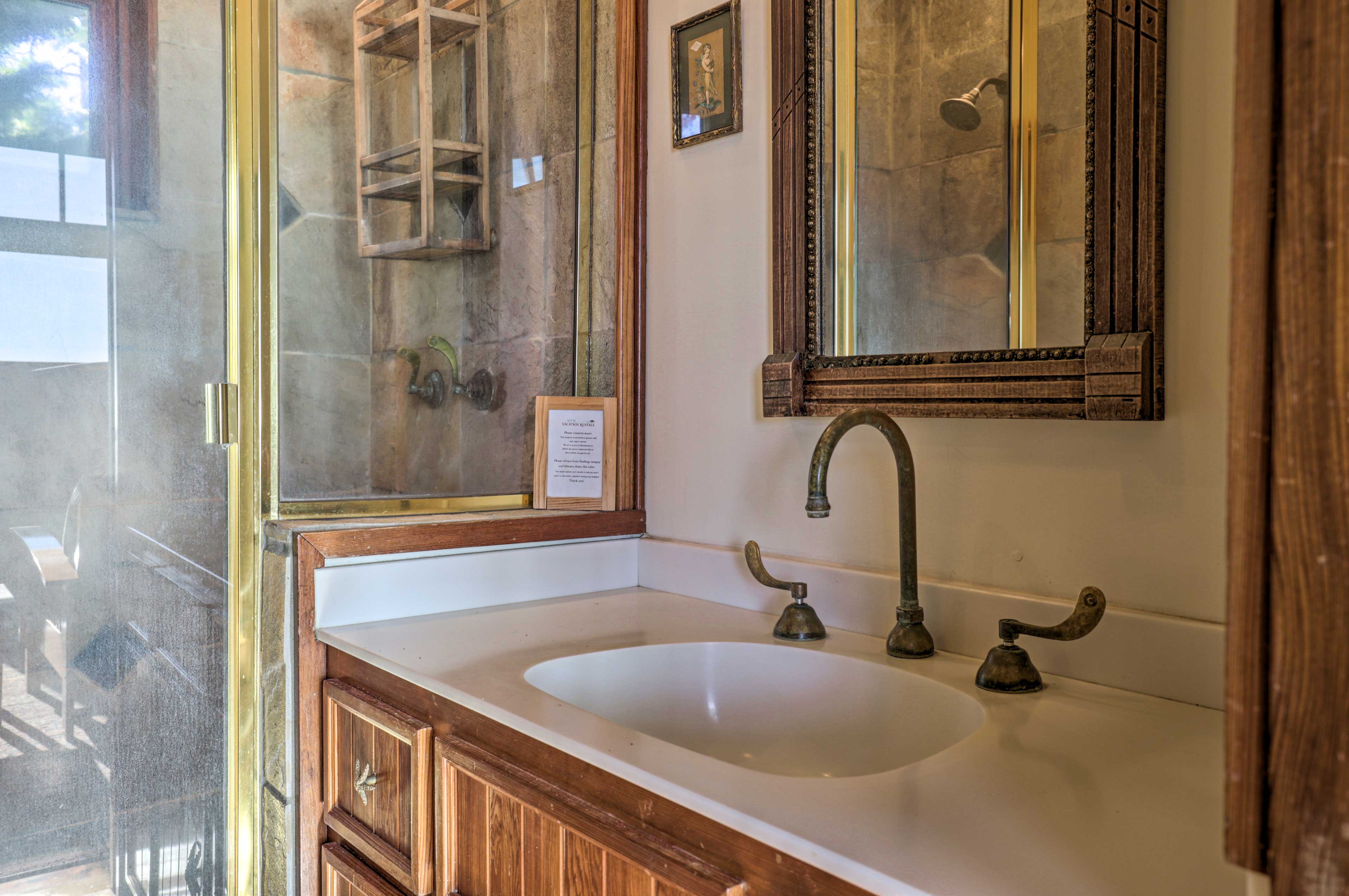 The en-suite bathroom boasts a stone-tiled shower.