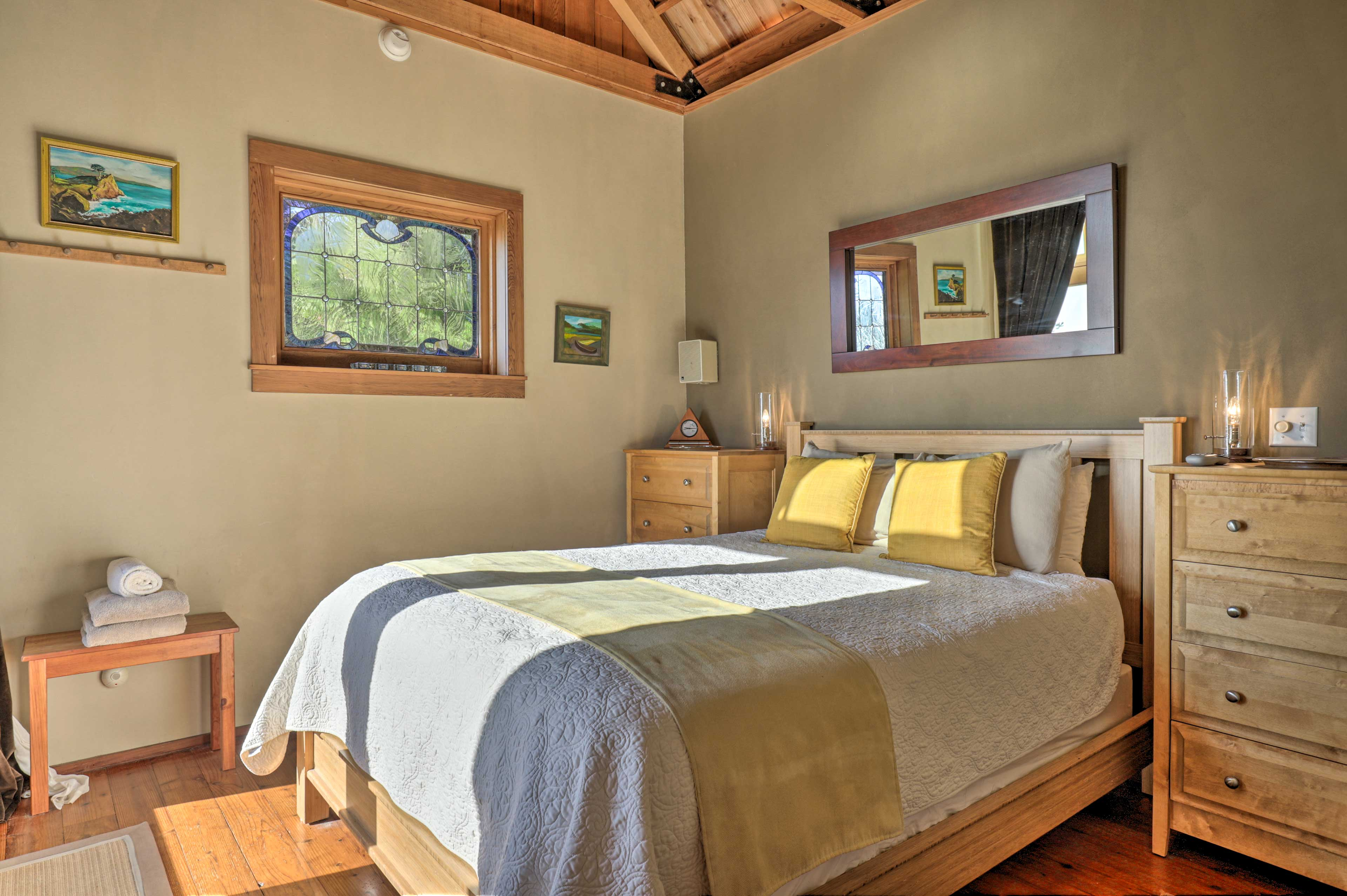 The master suite is complete with a queen bed.