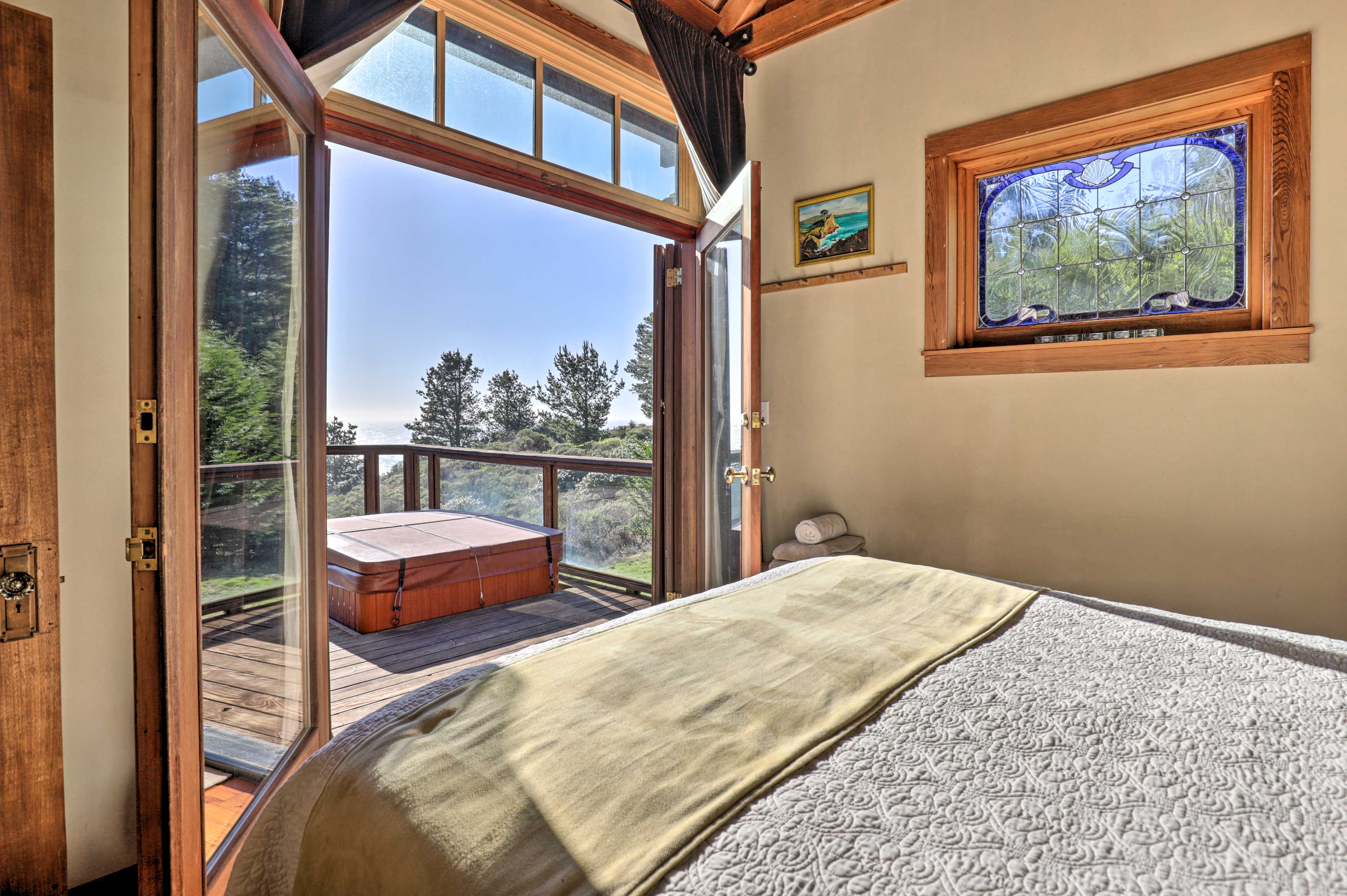 Walk out of the french doors to take a soak in the private hot tub.