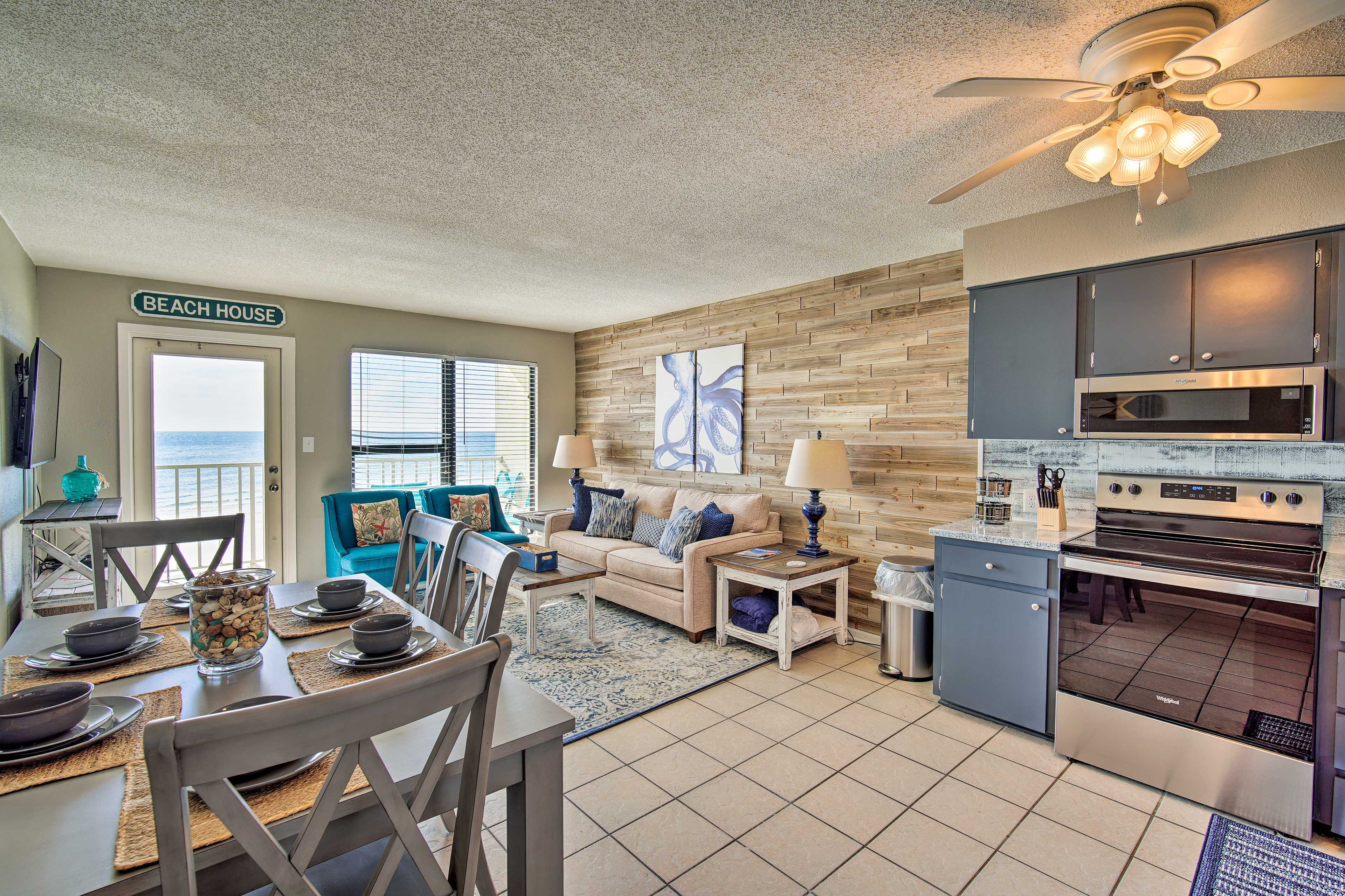 You'll find the open-concept living space cozy & bright.