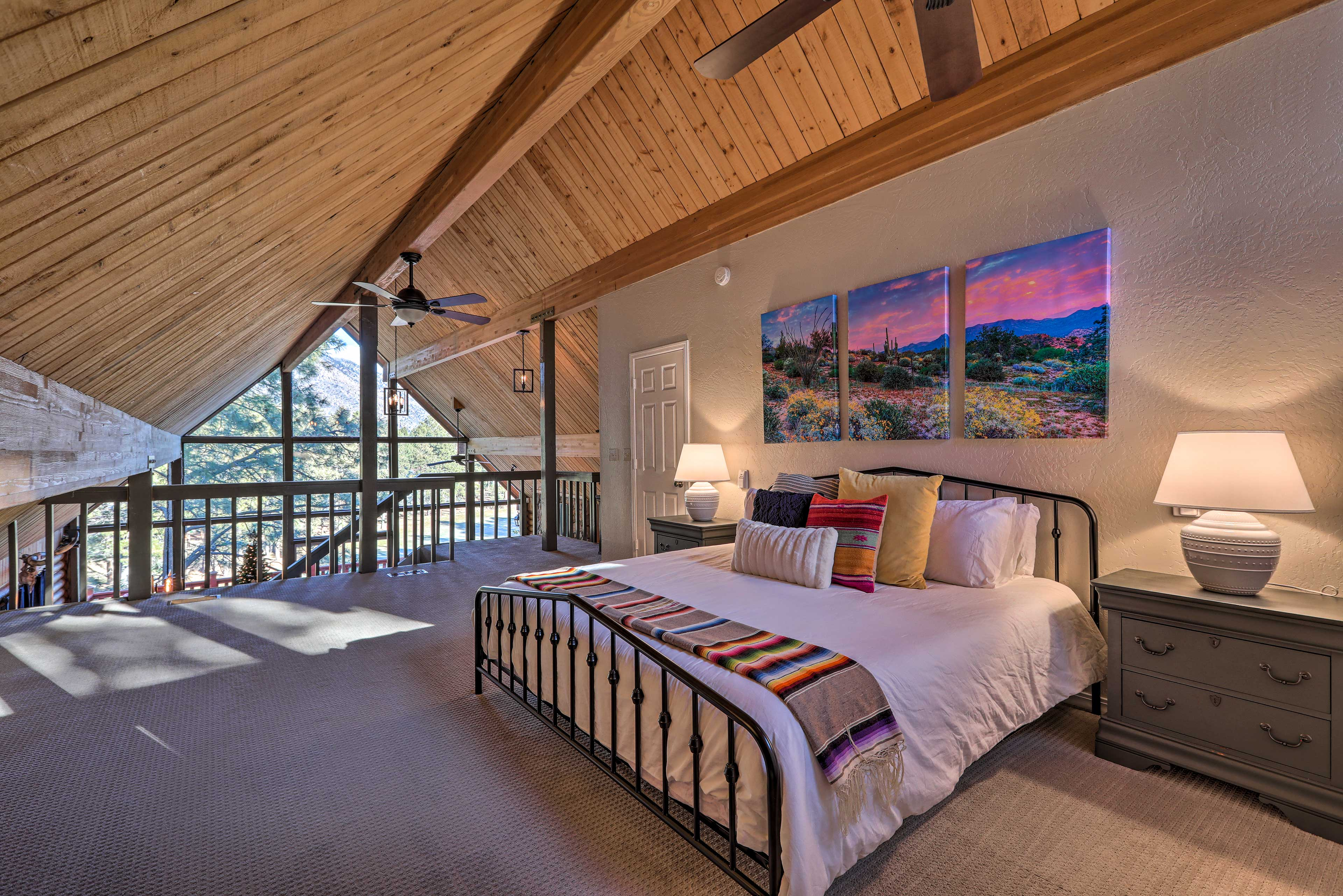 The master bedroom is located upstairs in the loft.