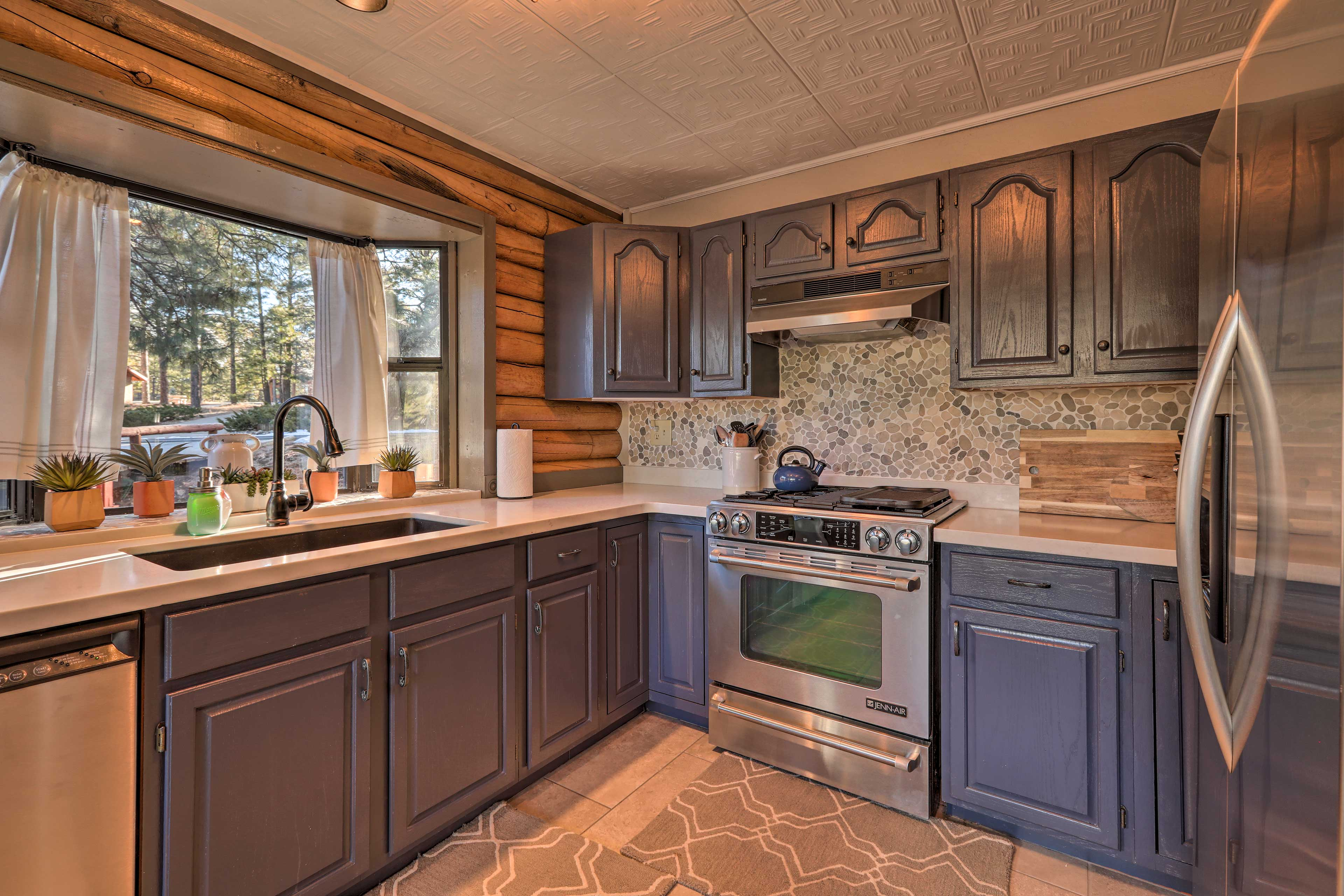 This kitchen blends a beautiful modern and rustic style together.