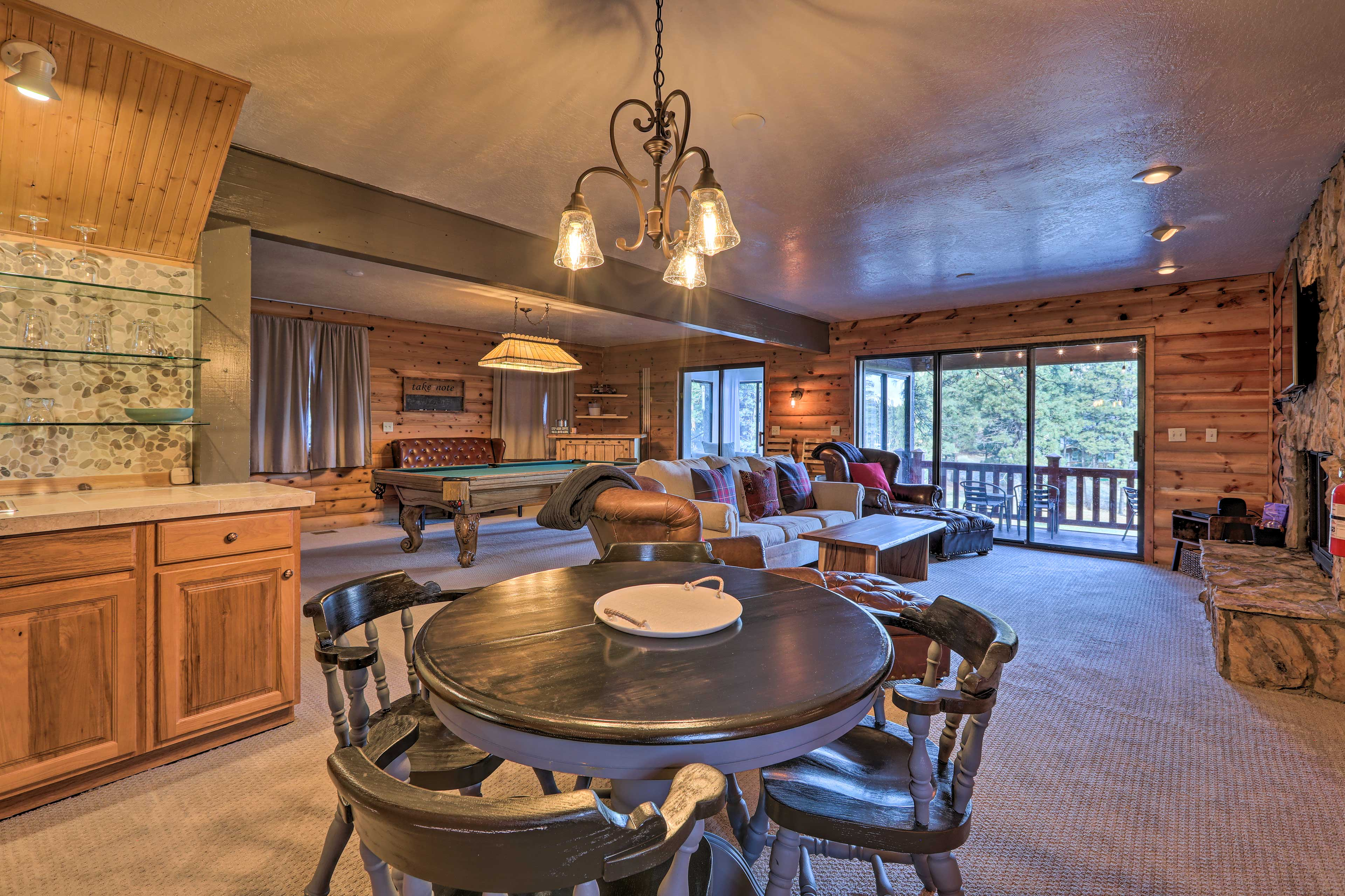 This space has a separate fireplace, mini-fridge, and a wet bar.