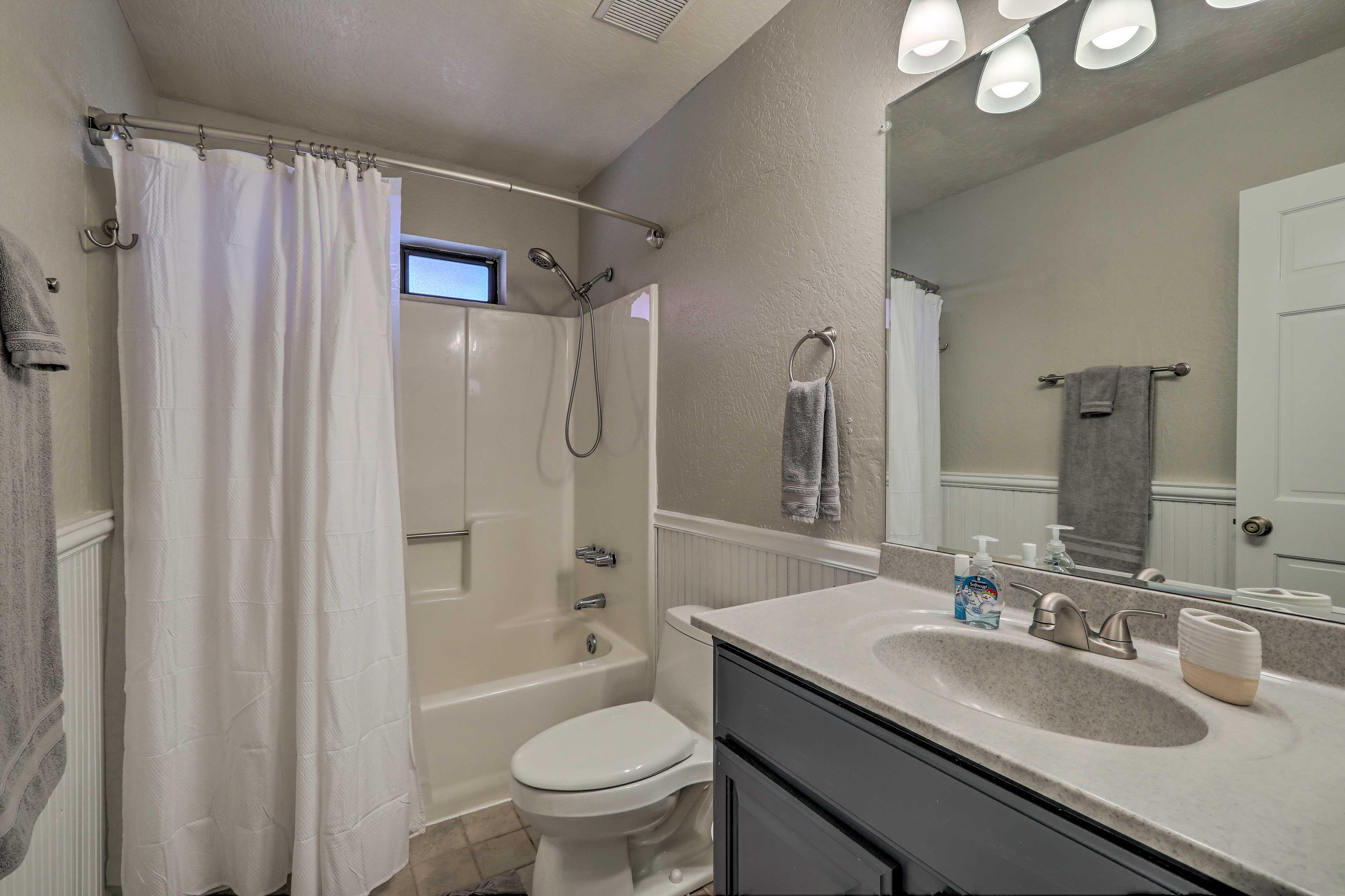 A third full bathroom has a shower/tub combo.