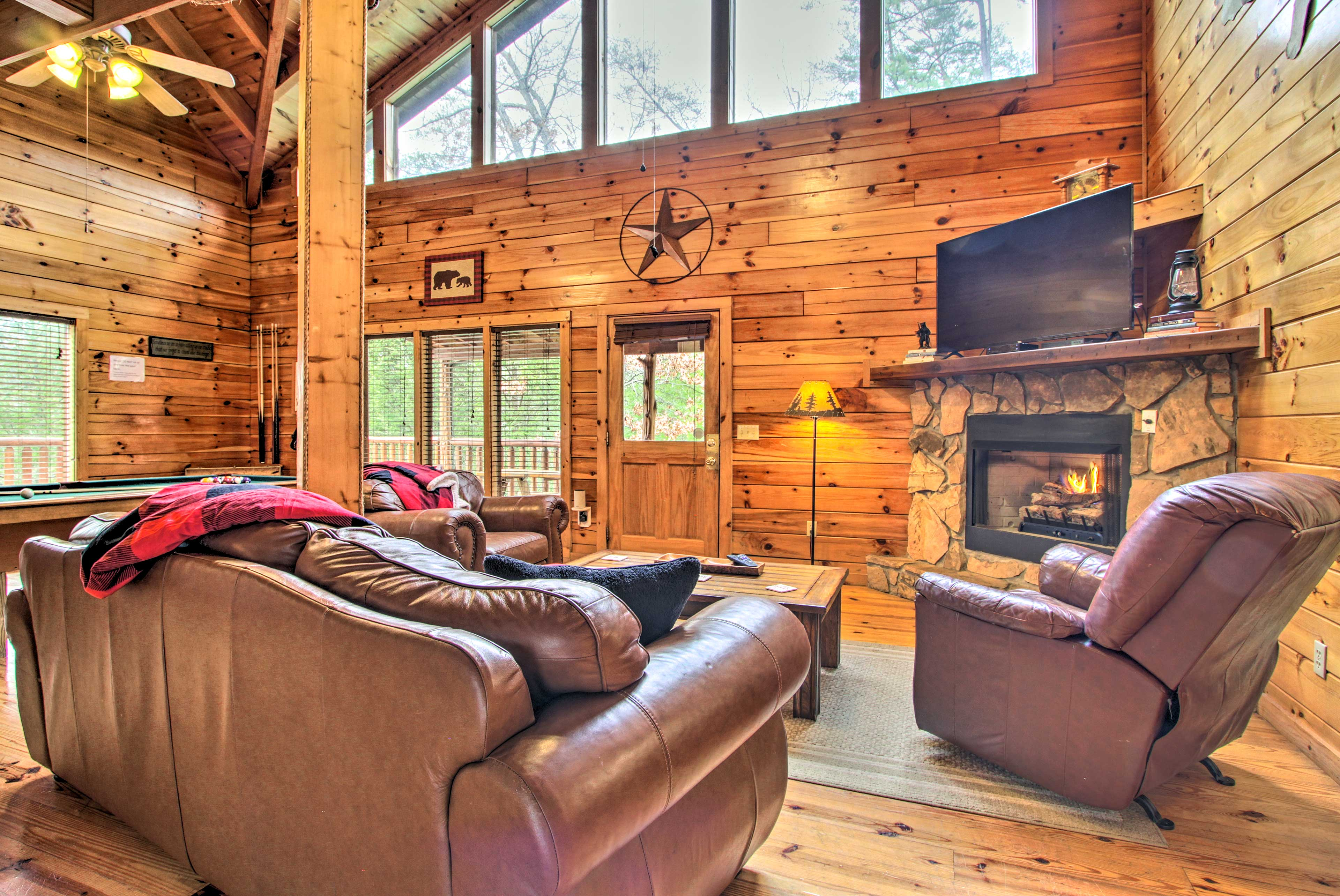 Unwind in the comfortably furnished living room and warm up by the fireplace.