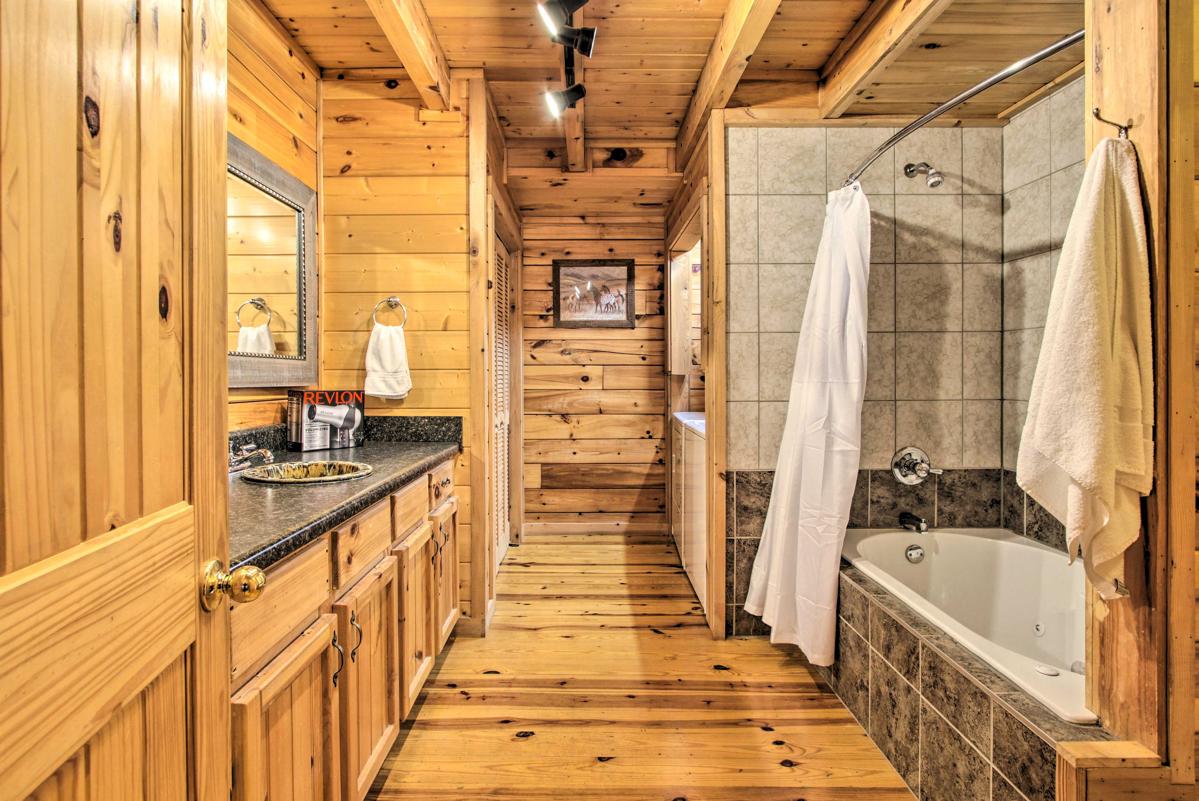 The master bathroom has a tub/shower combo and high-end touches.