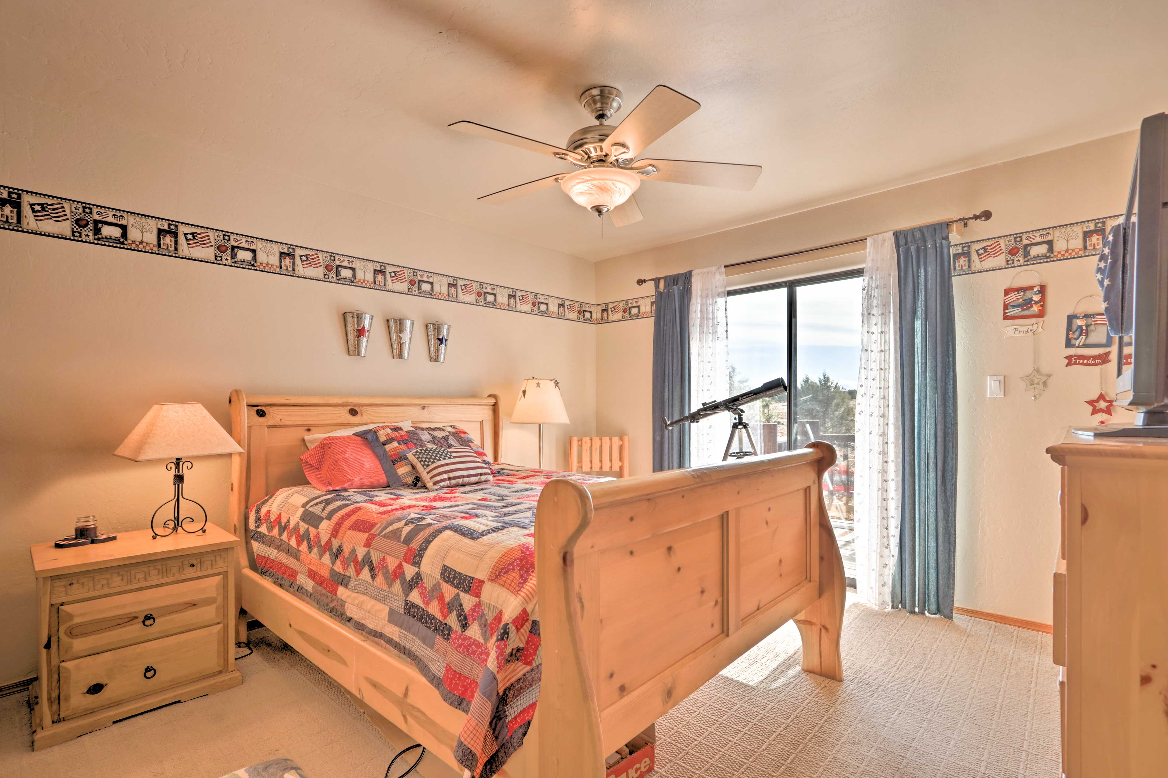 The master bedroom hosts a queen bed and a telescope for evening stargazing!