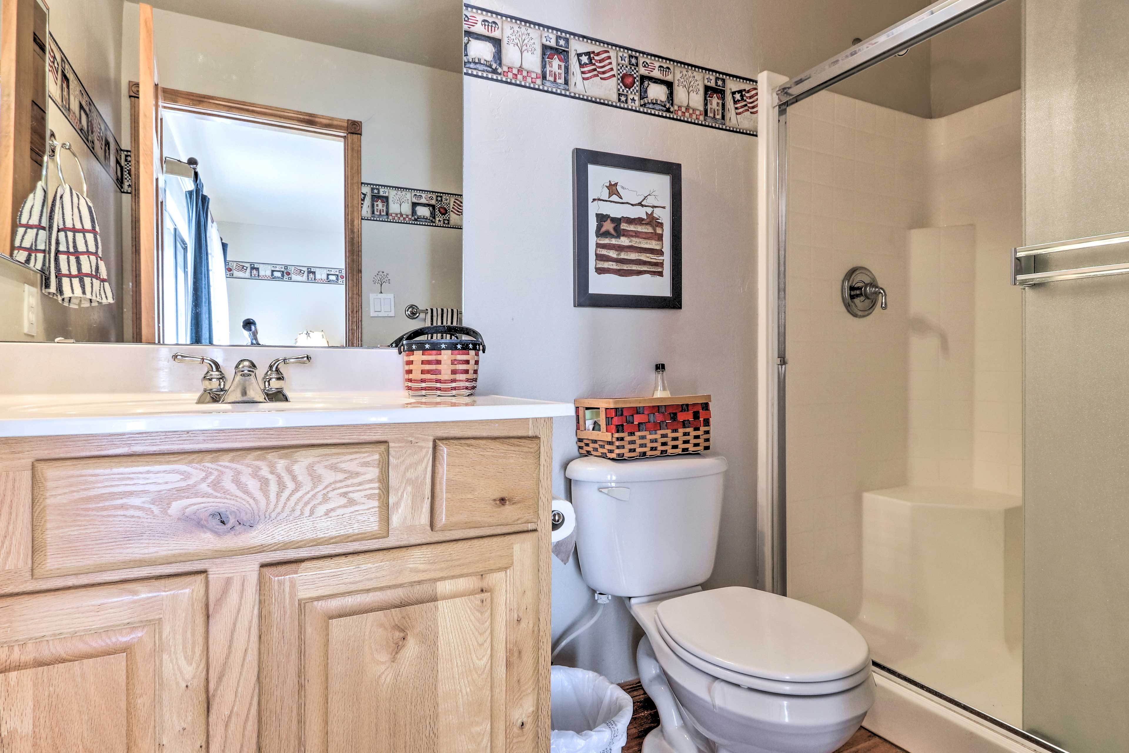 The first bathroom has a walk-in shower and vanity.