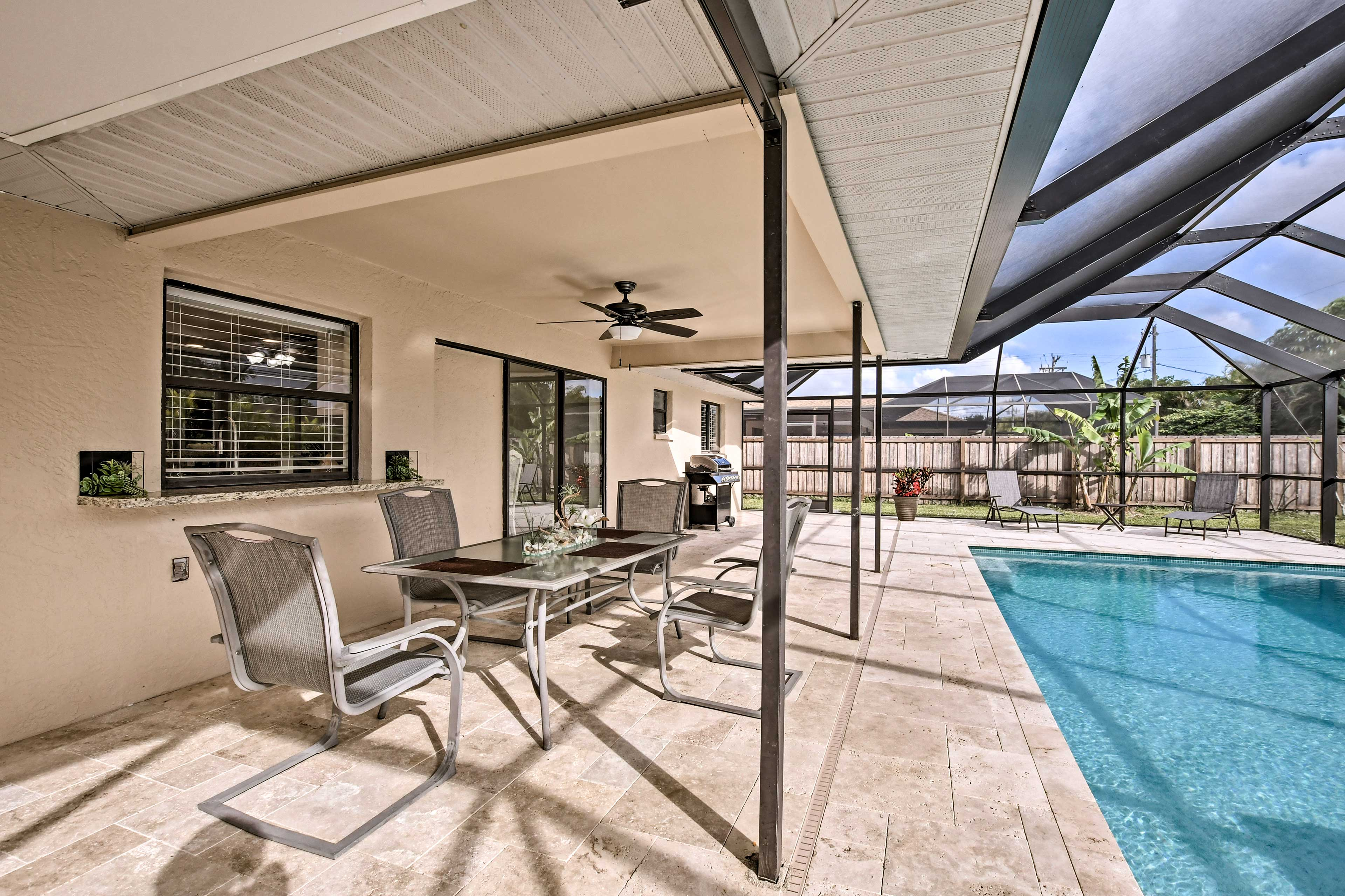 The yard includes a pool, lanai, and covered patio.