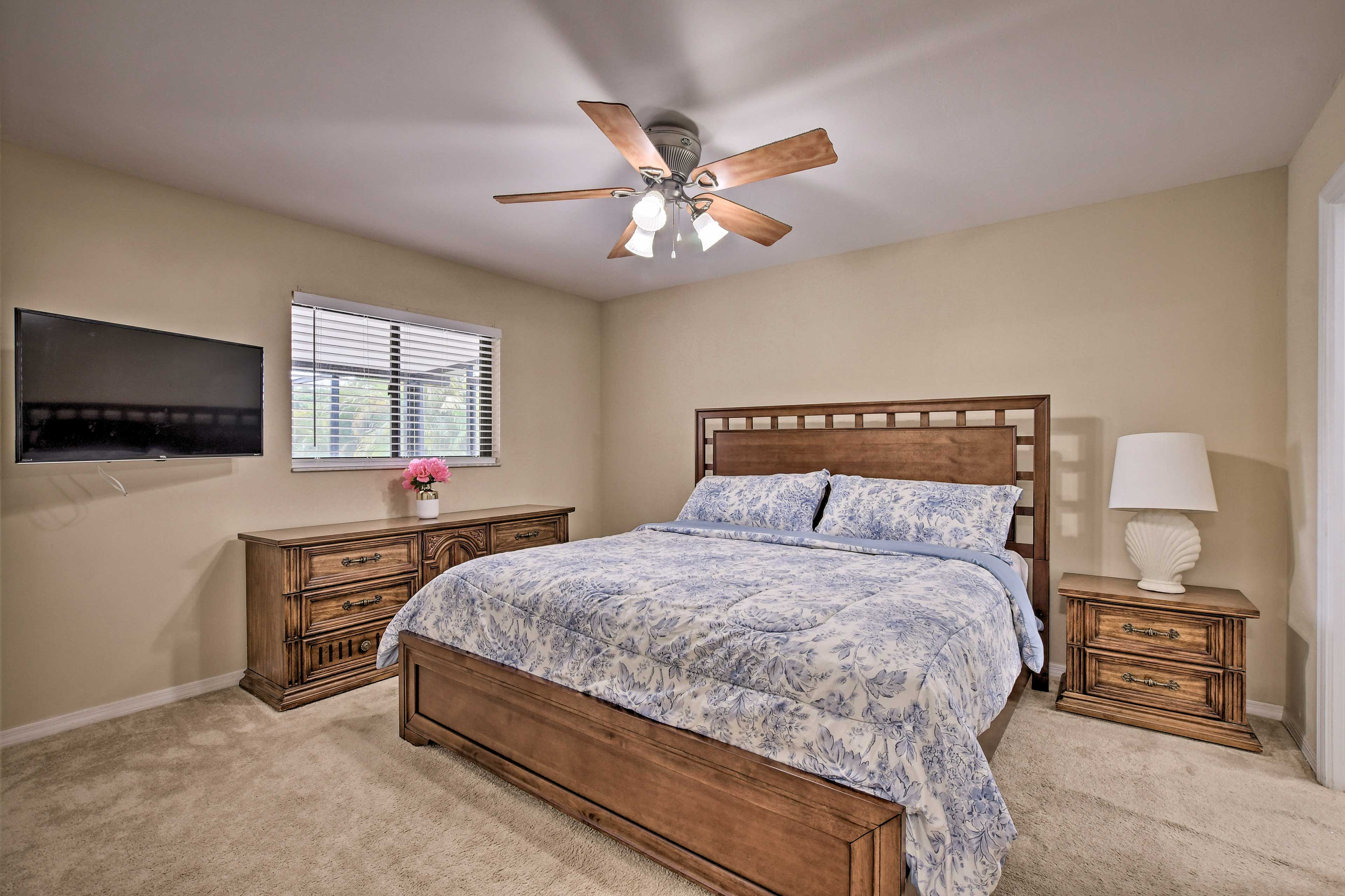 The master bedroom features a king bed and flat-screen TV.