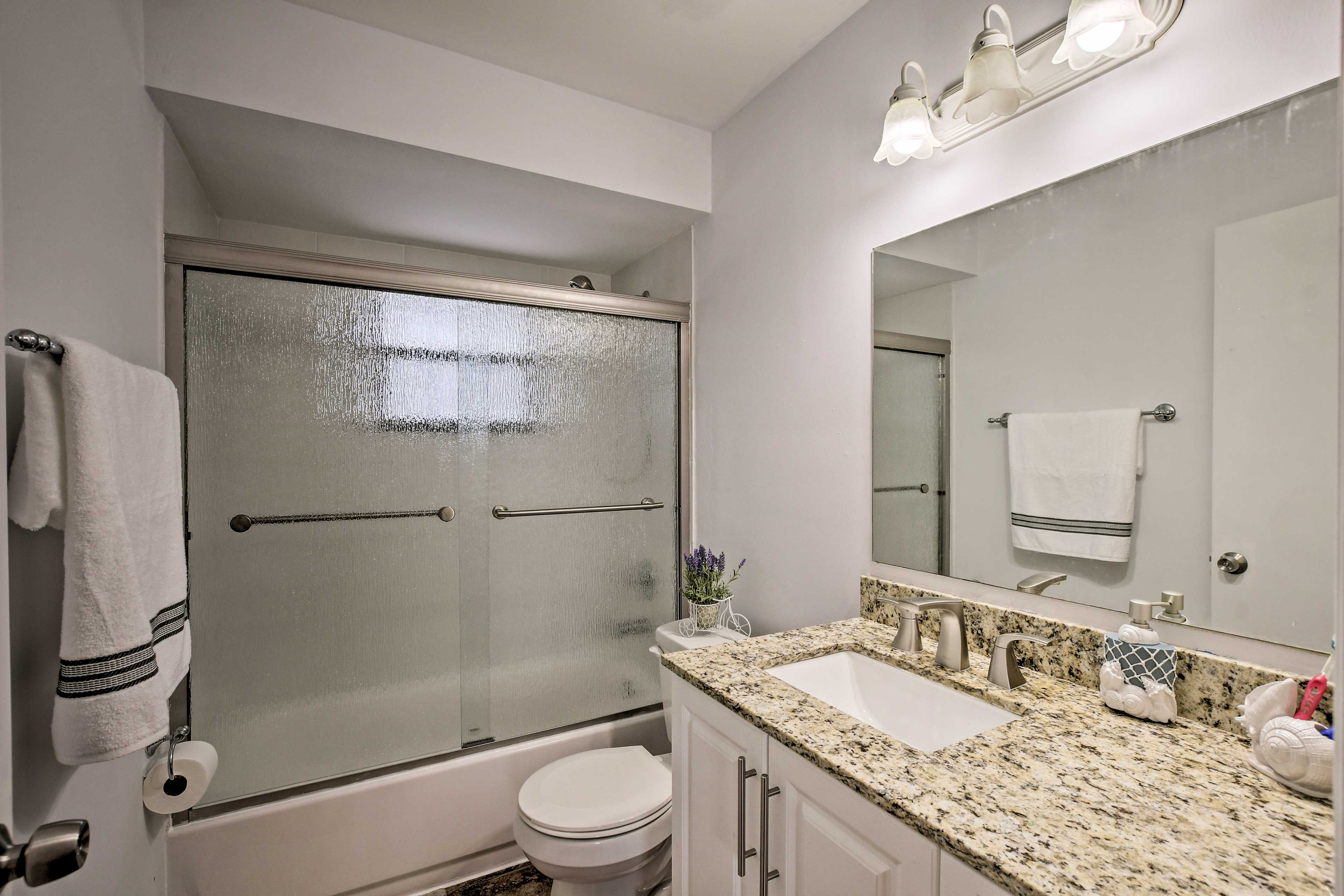 This bathroom has a shower/tub combo.