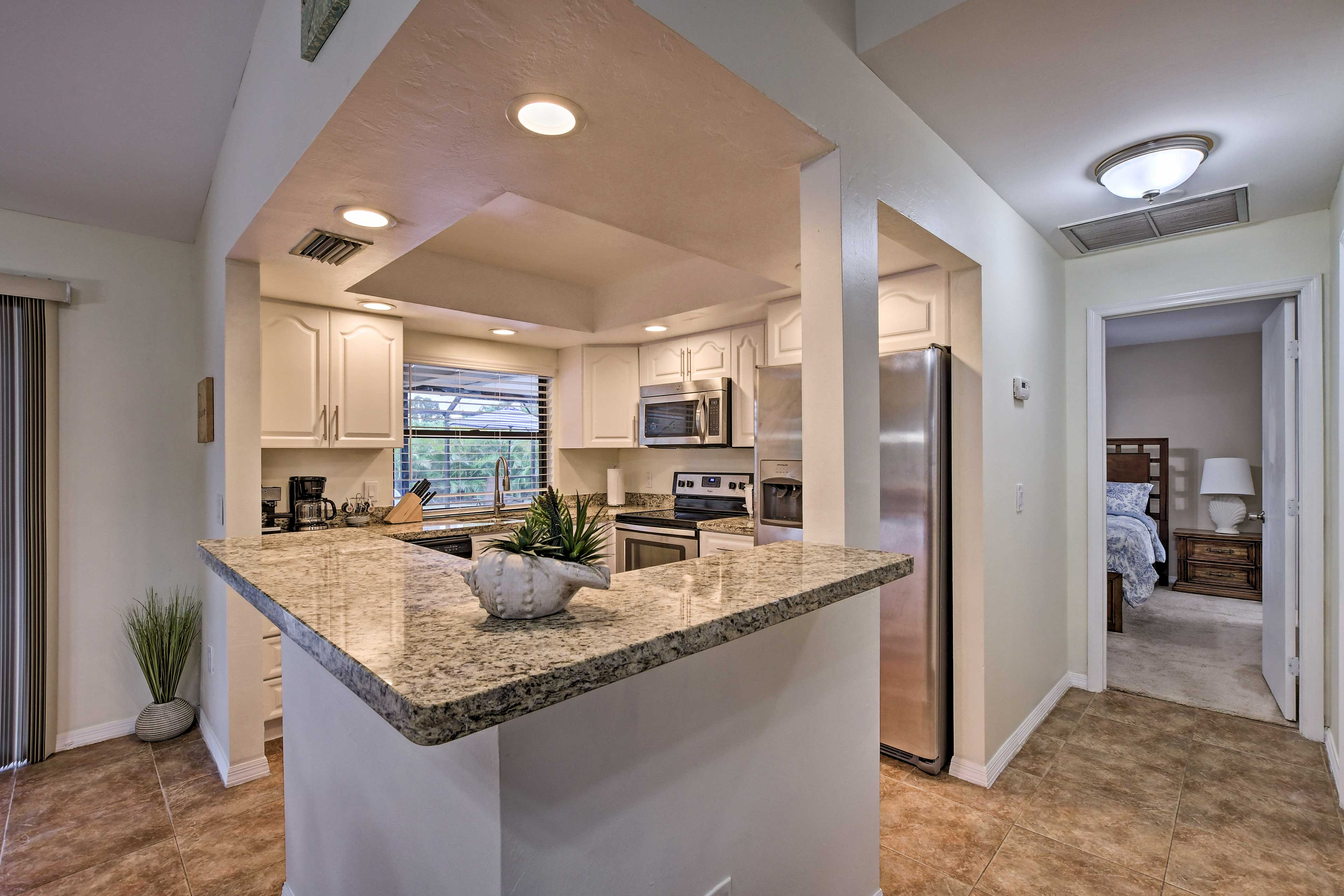 The fully equipped kitchen has an island perfect for setting up a buffet.