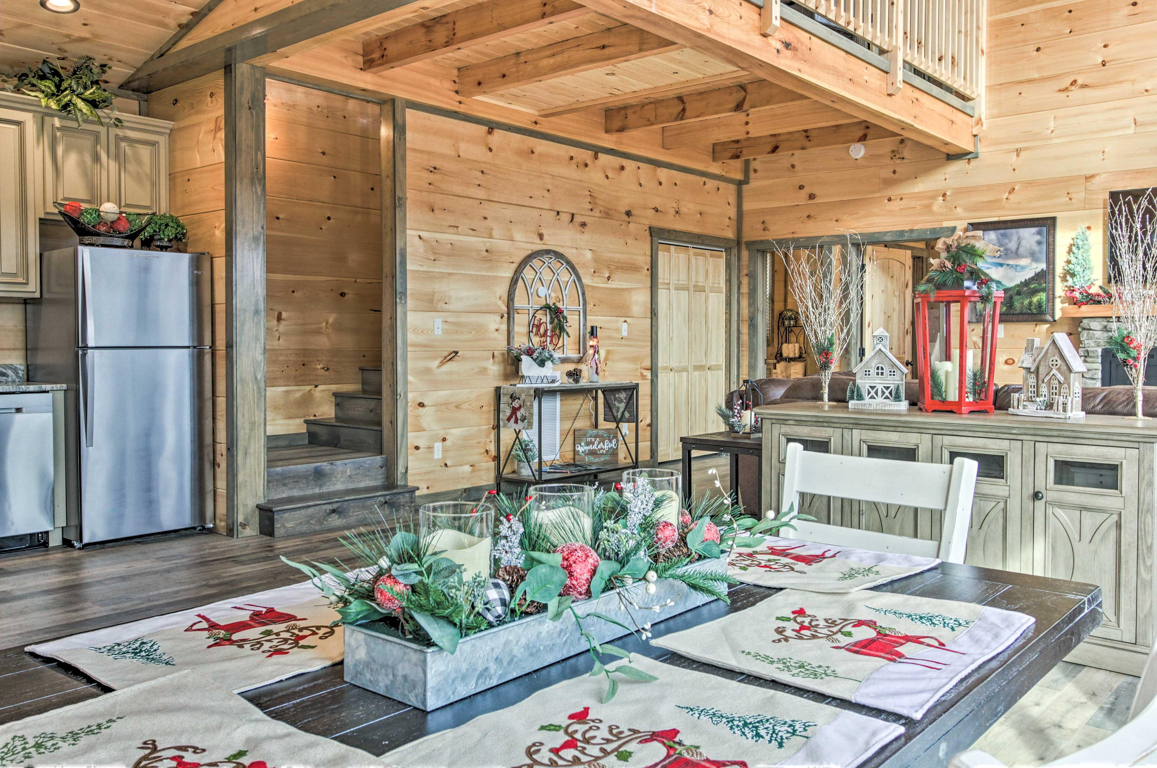 Wood paneling and cabin decor keep this new cabin feeling homey.