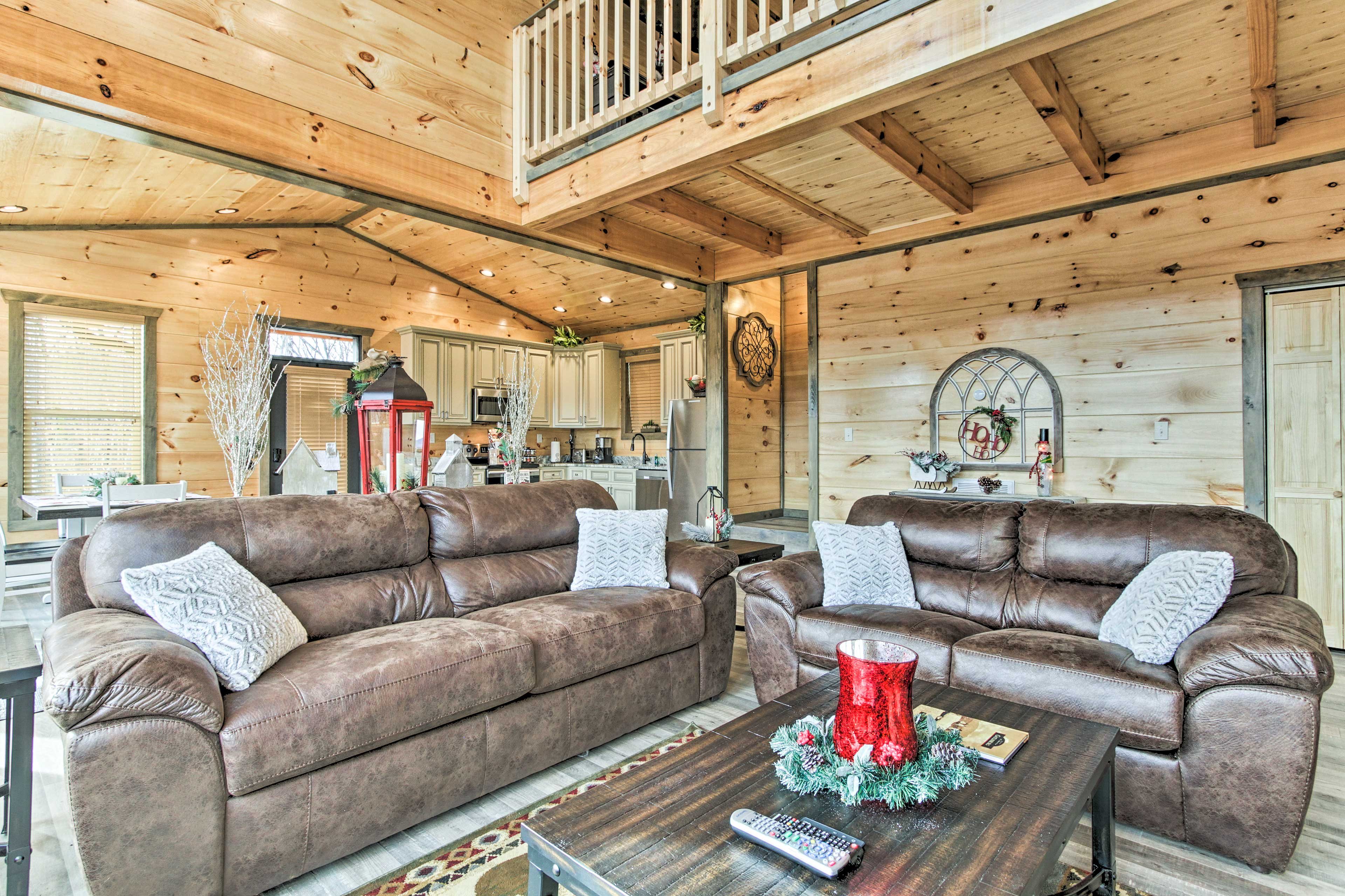 The open floor plan and vaulted ceiling make this cabin feel extra spacious!