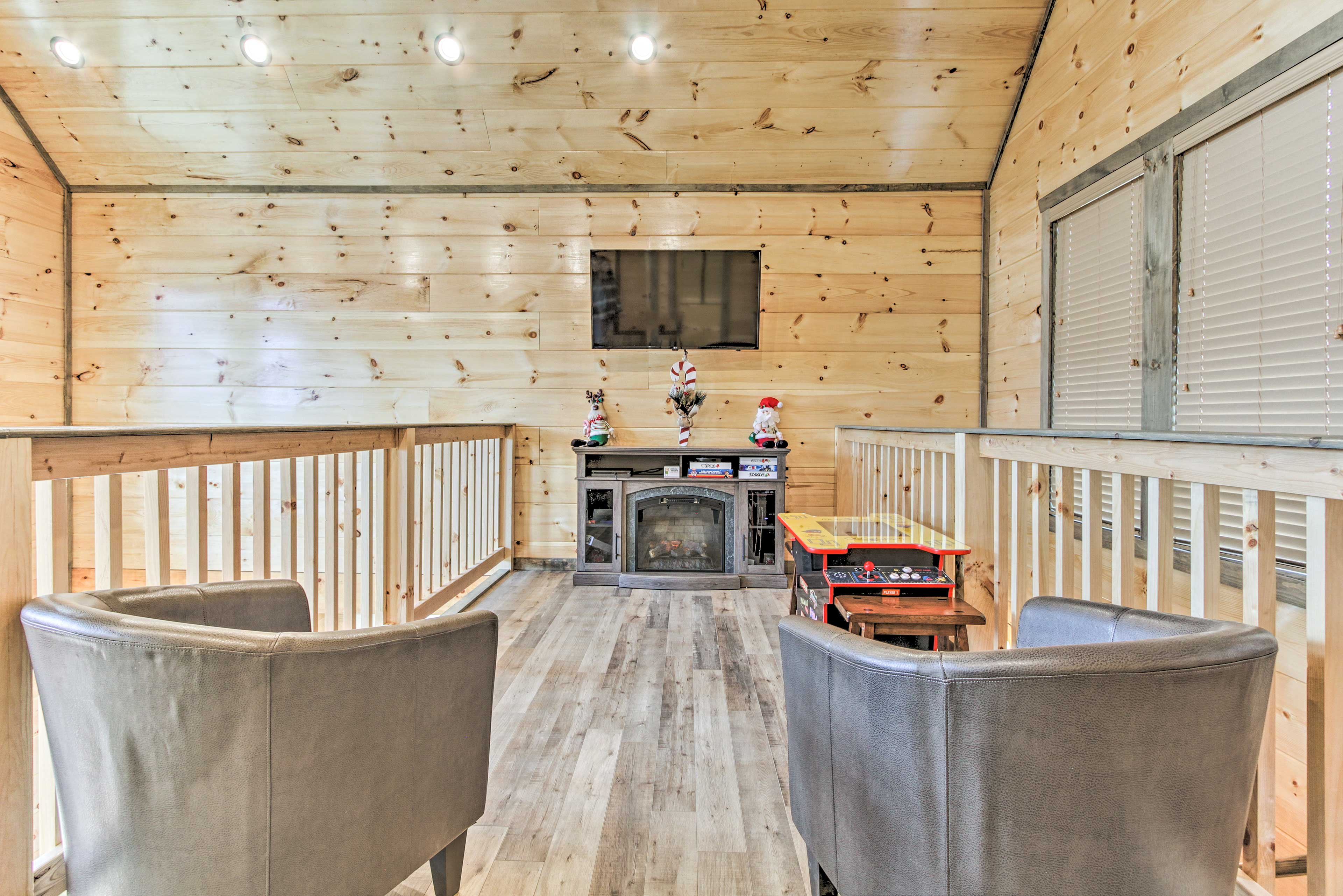 Kick back and relax in the loft with a second fireplace.