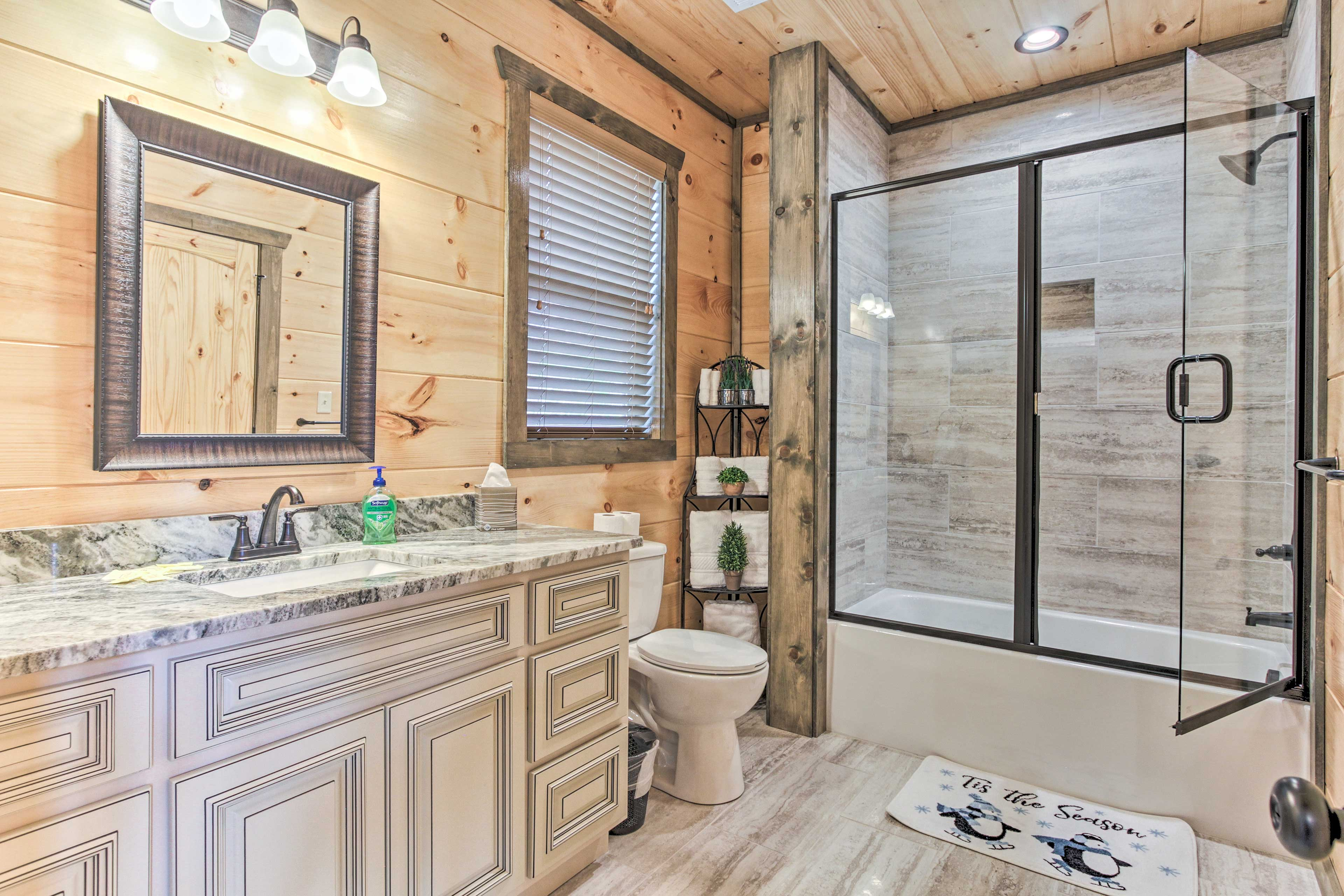 The en-suite bathroom features lots of counter space and a tile-lined shower.