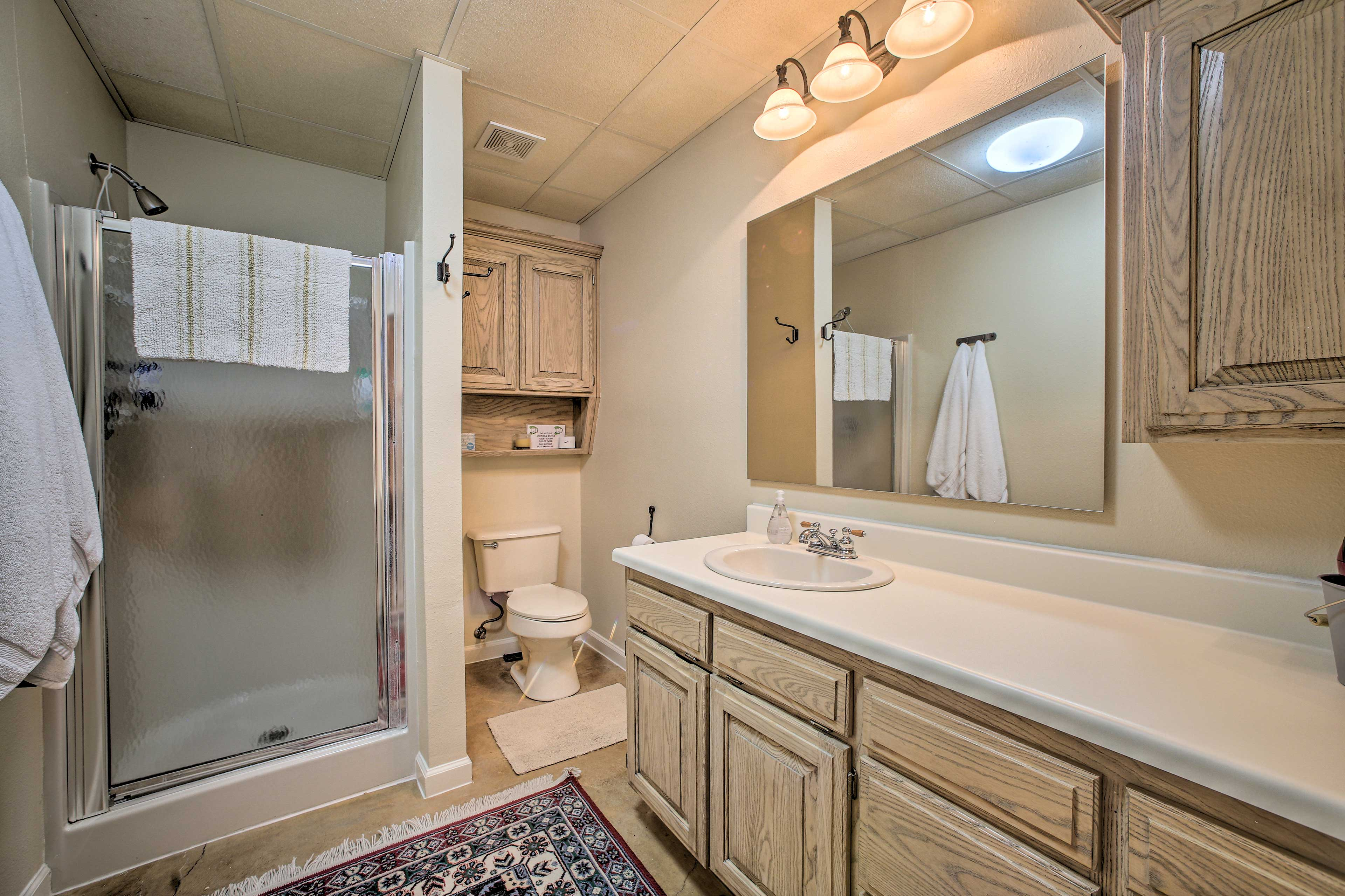 The en-suite master bathroom has a shower and plenty of counterspace.