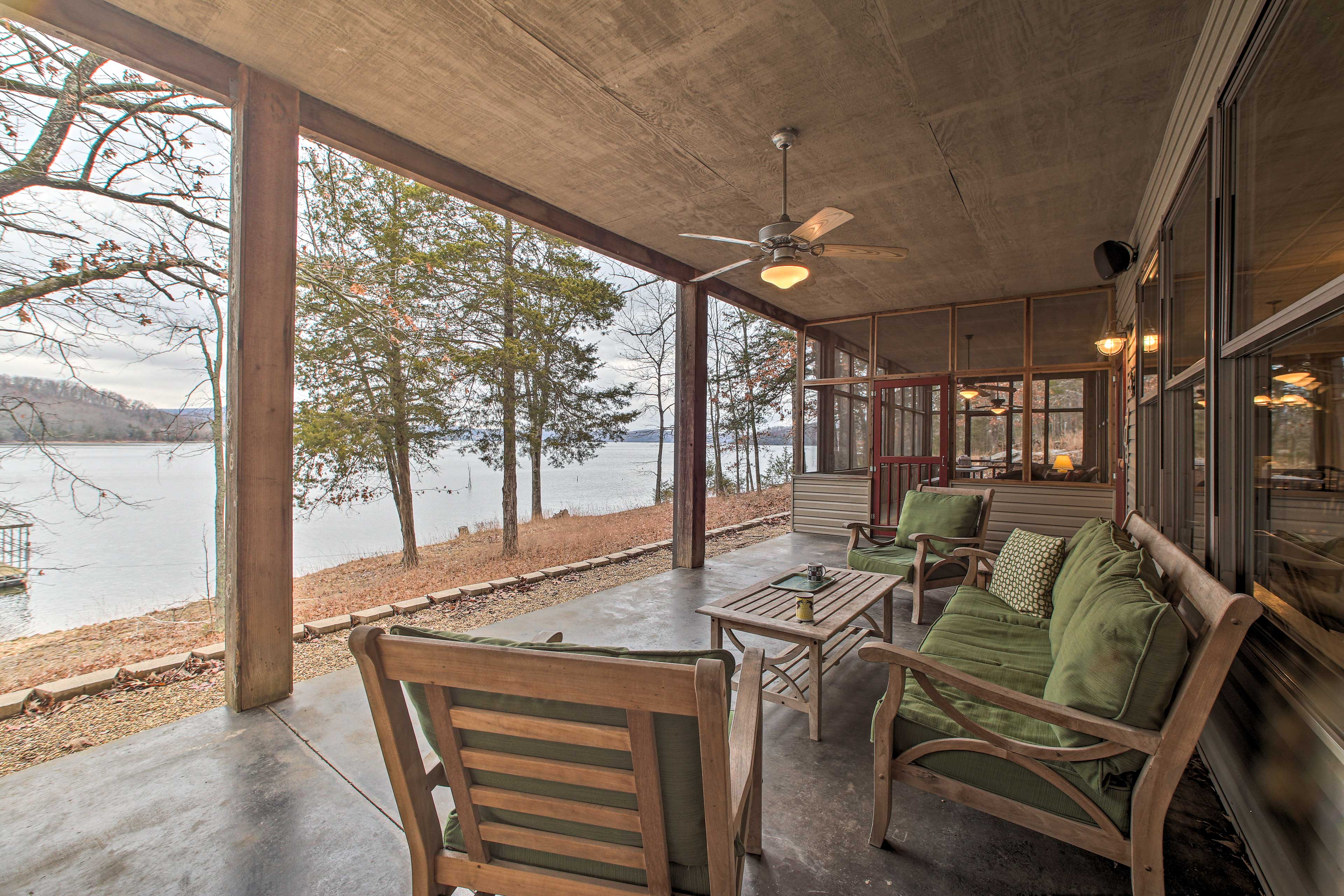 Take your morning coffee of tea on this vacation rental's covered patio.