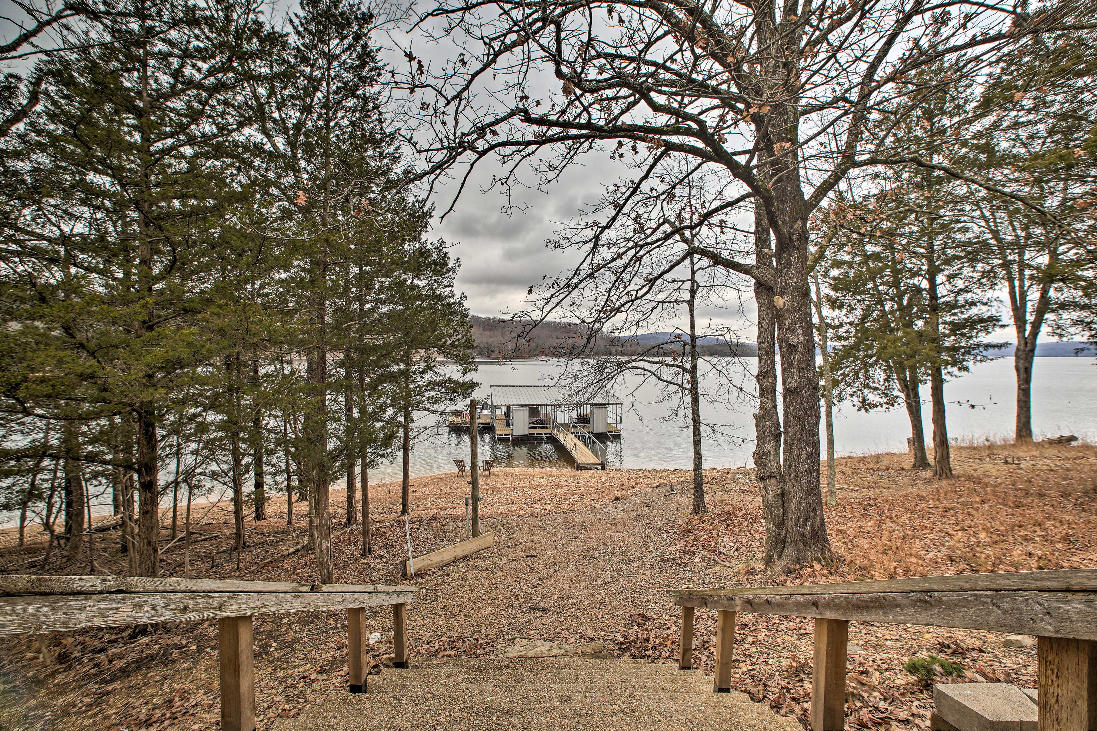 Out back, you'll enjoy direct access to beautiful Beaver Lake!
