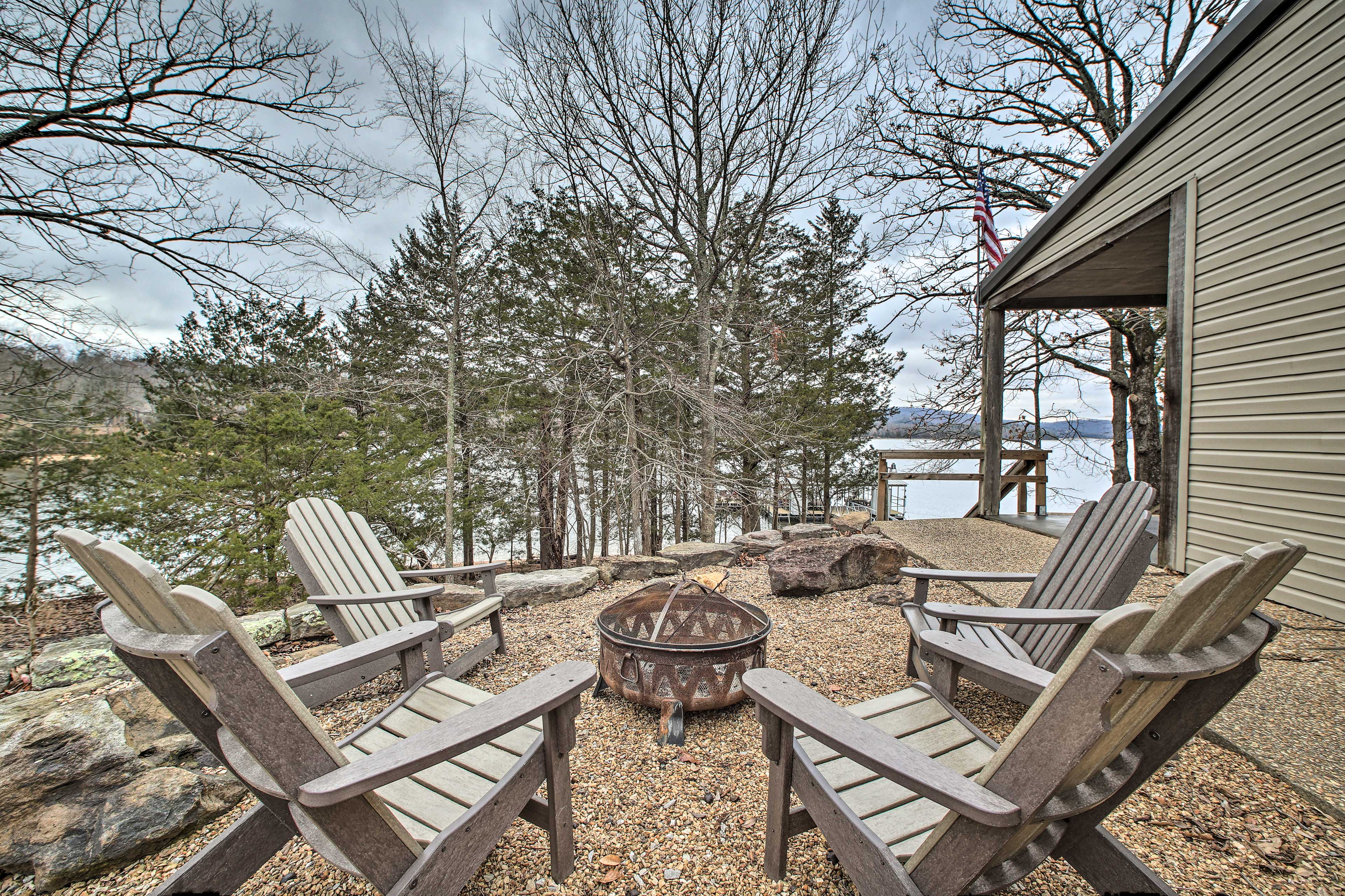 Gather round the fire in these comfortable Adirondack chairs.