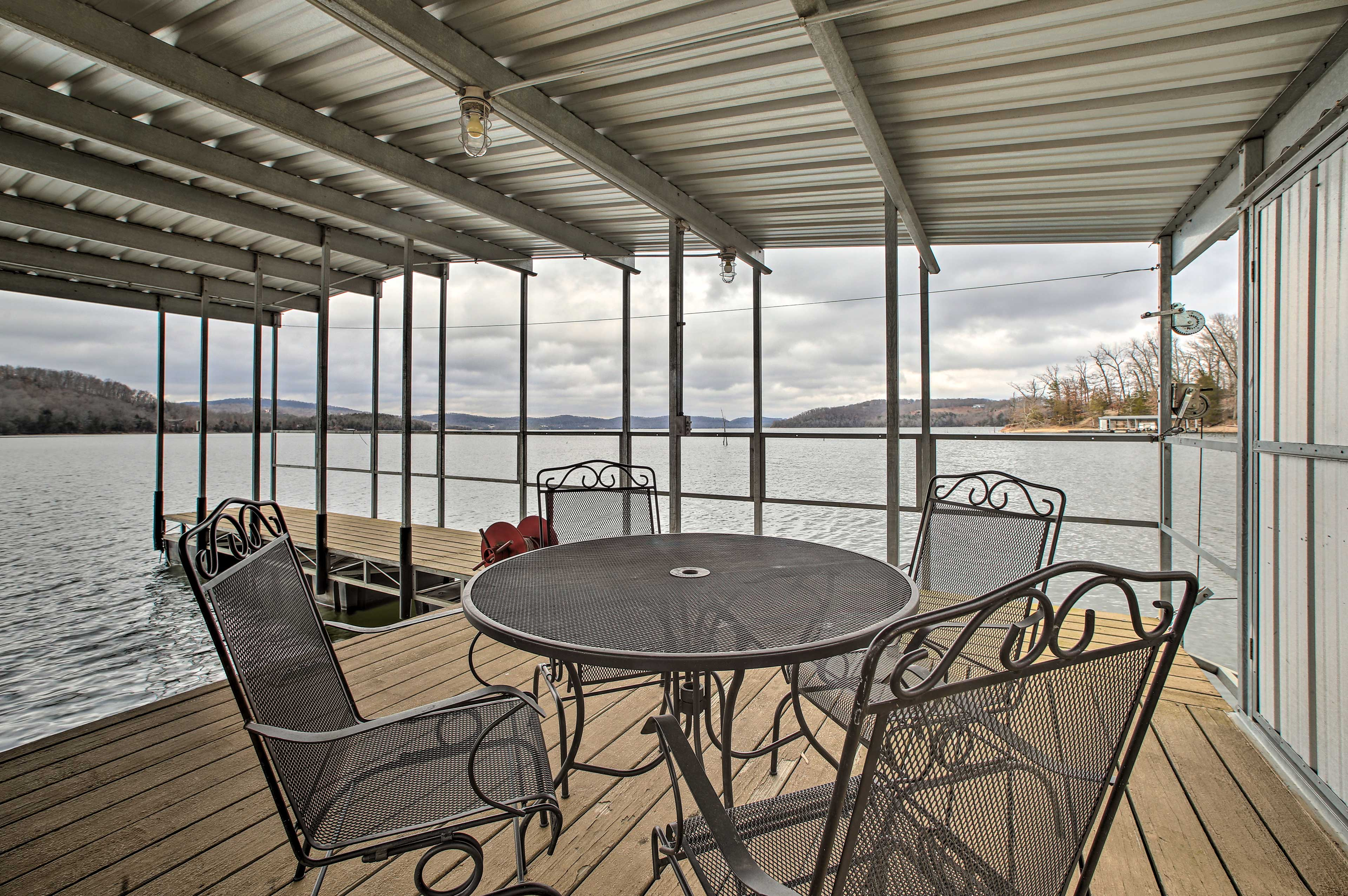 Dine directly on the water at this Beaver Lake vacation rental!